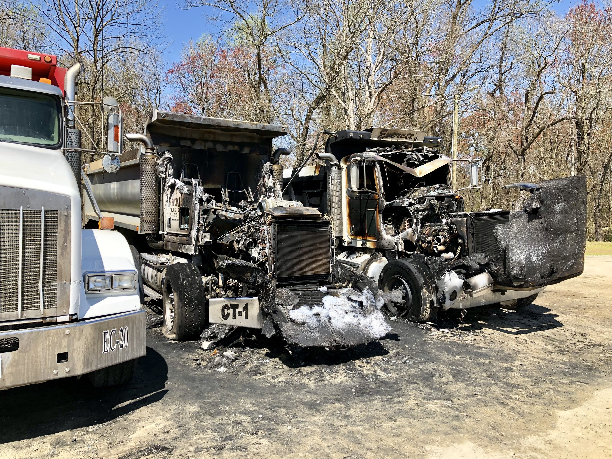 Two dump trucks, one belonging to Carolina Trucking and one to Everett's Clearing and Grading, were destroyed in an early morning fire. Photo by Catherine Hardee / Neuse News
