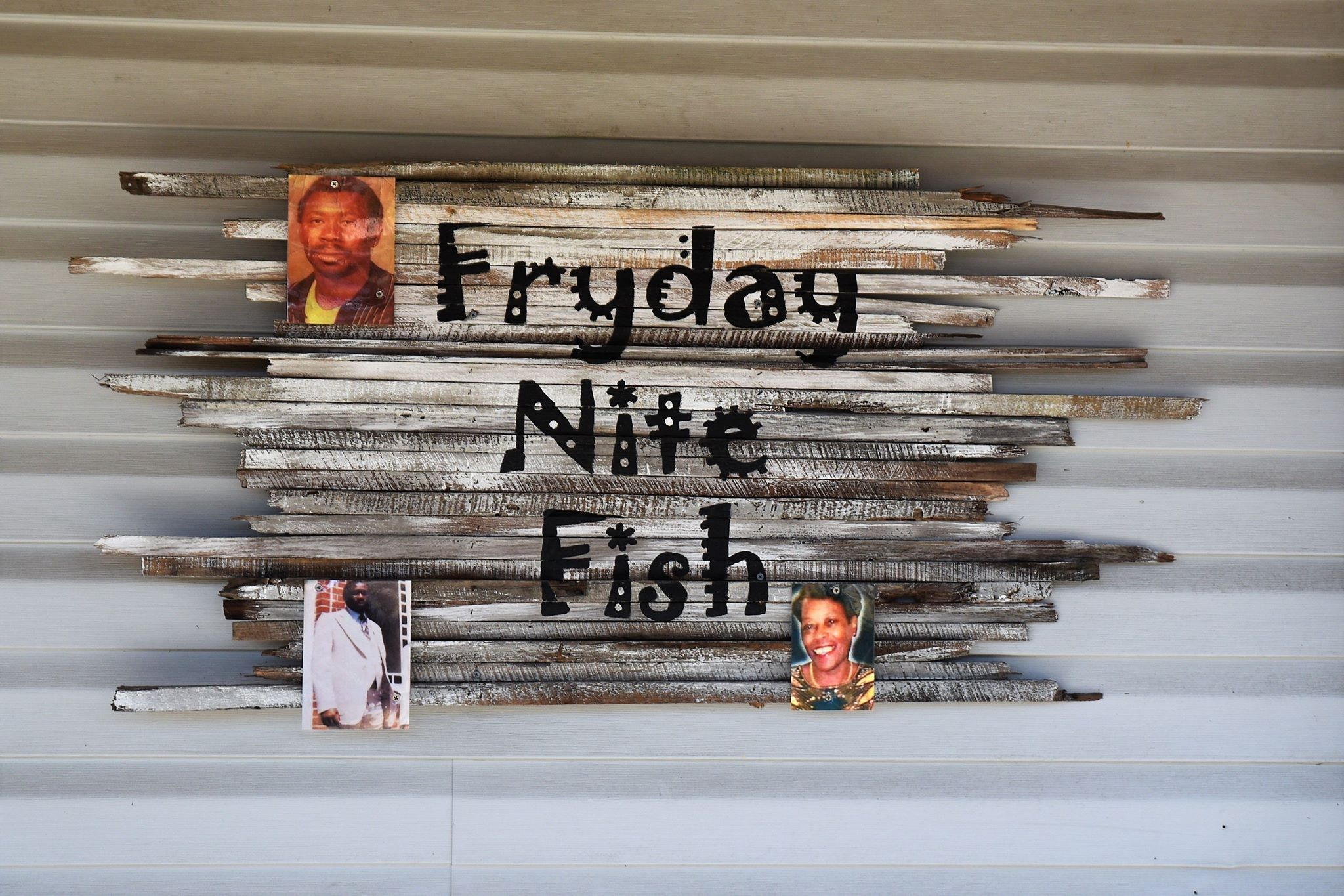 Pictures of family who have inspired the restaurant adorn the sign at Fryday Nite Fish.