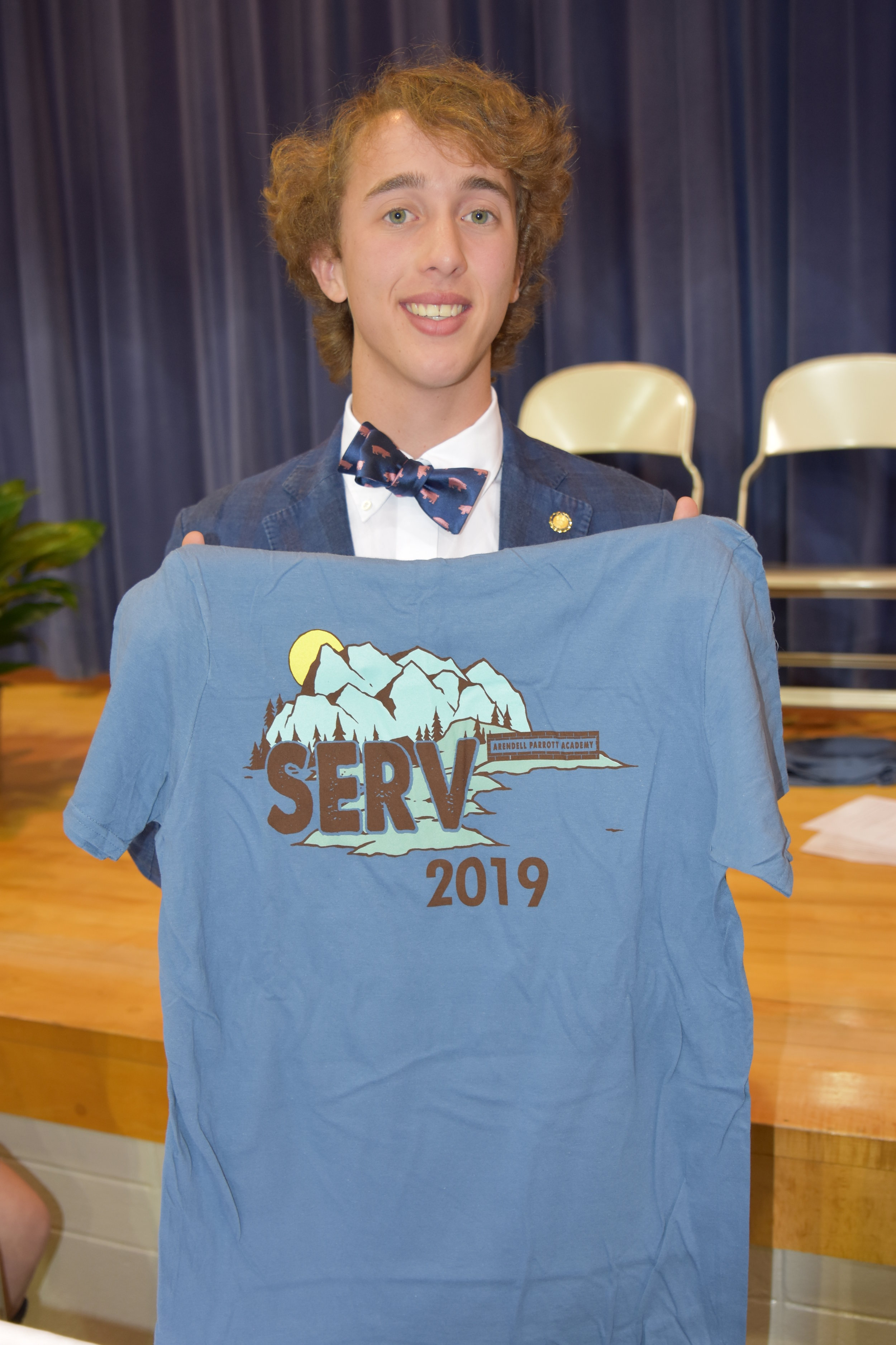 Senior Jeff Bland designed the SERV t-shirt that each inductee received.