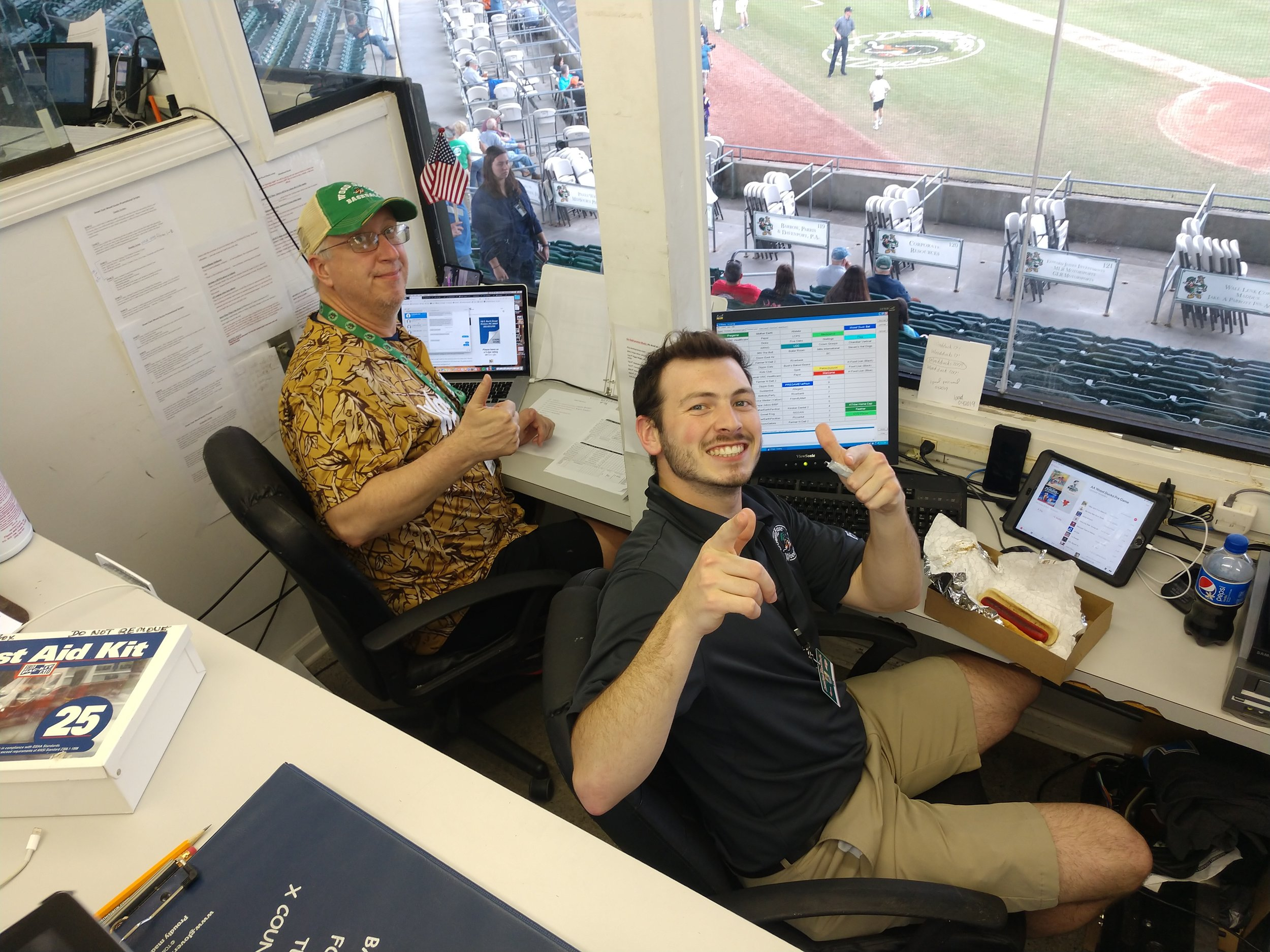 The calm before the storm as Wood Ducks' video board operator Sam Lee tries to keep Bryan's spirits high. Photo by Junious Smith III / Neuse News