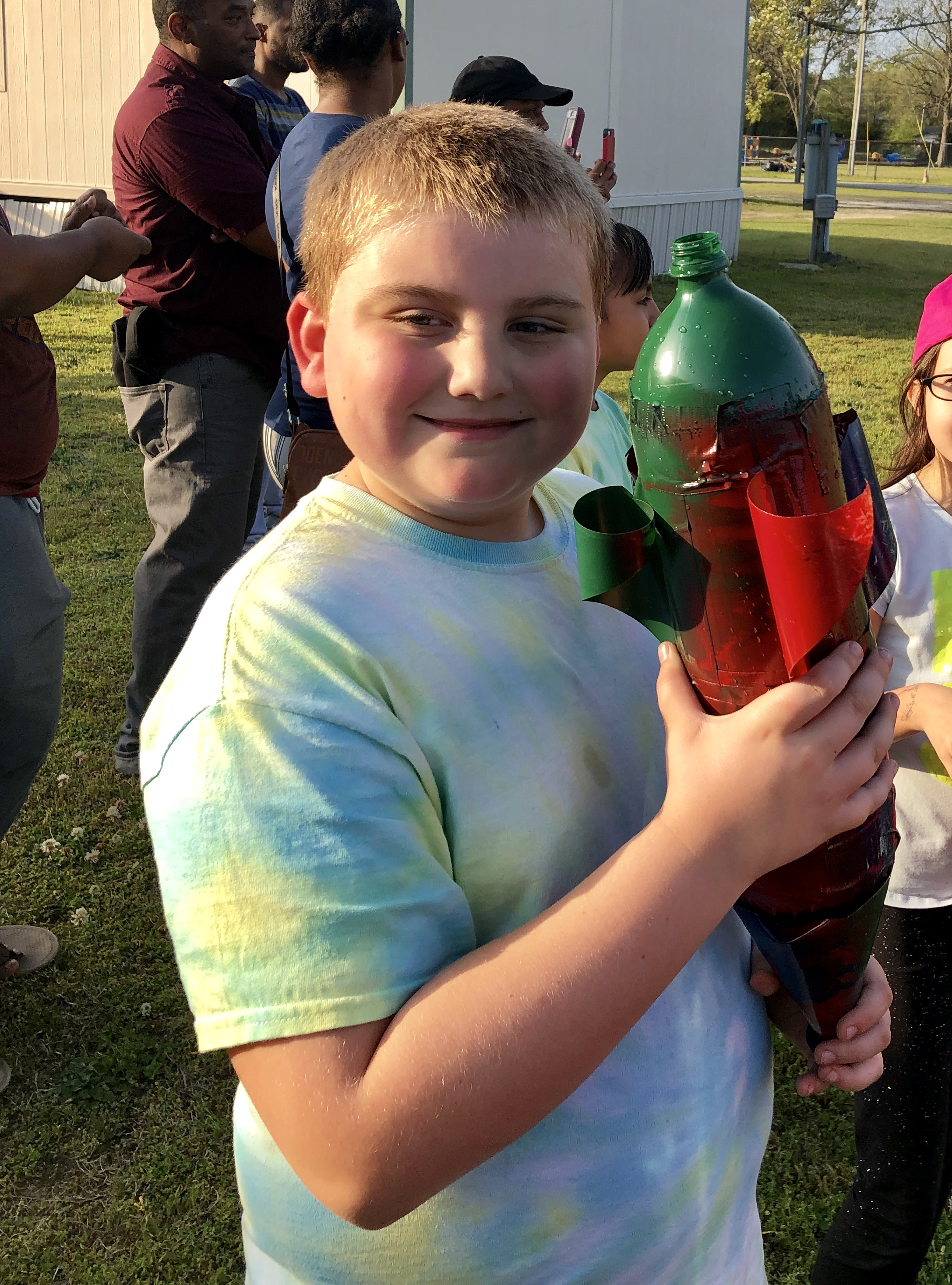 Third-grader Easton Vinson holds his rocket prior to shooting it off. Photo by Catherine Hardee / Neuse News