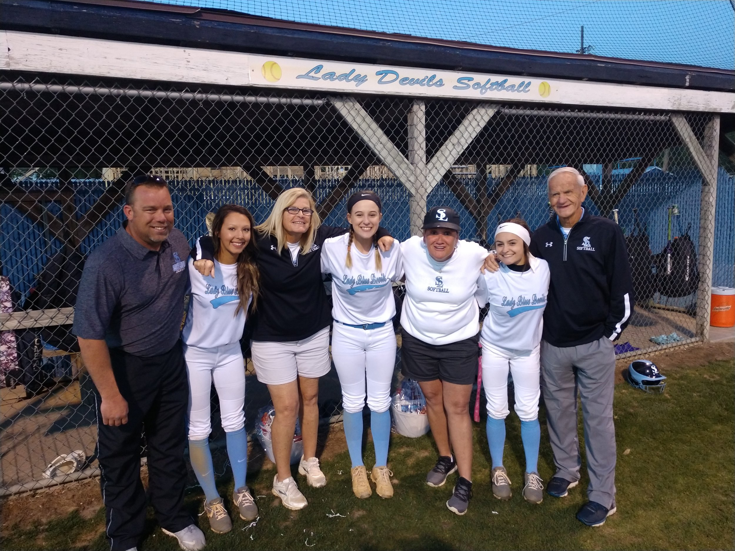 South Lenoir's three seniors, from left, Allie Parker, Samantha Sutton and Kenly Hardison played their final regular-season home game Tuesday. Standing next to them are, from left, assistant coach Brian Lucas, head coach Lisa Smith, and assistant coaches Mishella Craine and Thurman Pate. Photo by Junious Smith III / Neuse News