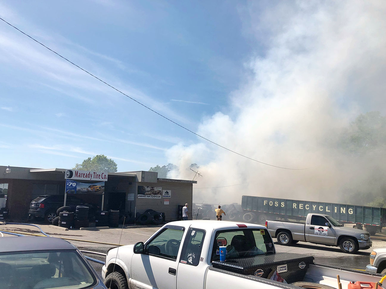 Firefighters battle the blaze at Maready Tire Company. Photo by Catherine Hardee / Neuse News