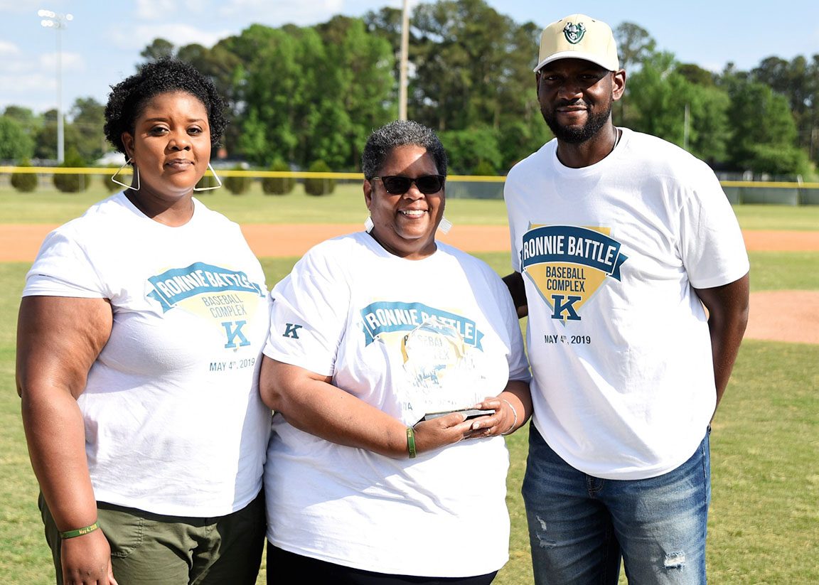 Members of Ronnie Battle's immediate family — from left, Torise Battle Young (daughter), Birta Battle (wife) and Joel Battle (son) — pose for a photo following Saturday's ceremony. Photo by William 'Bud' Hardy / Neuse News