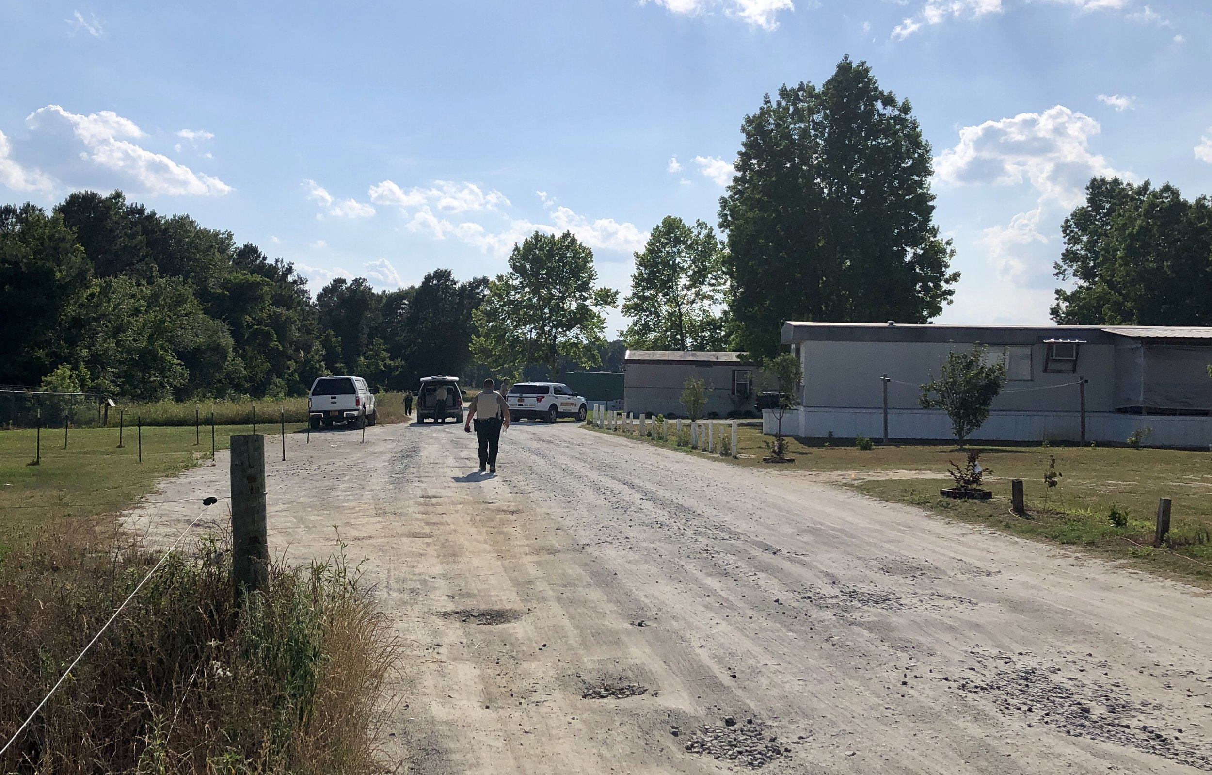 Deputies with the LCSO continue to investigate the scene where shots were fired on Monday on Lonnie Lane in Pink Hill. Photo by Catherine Hardee / Neuse News