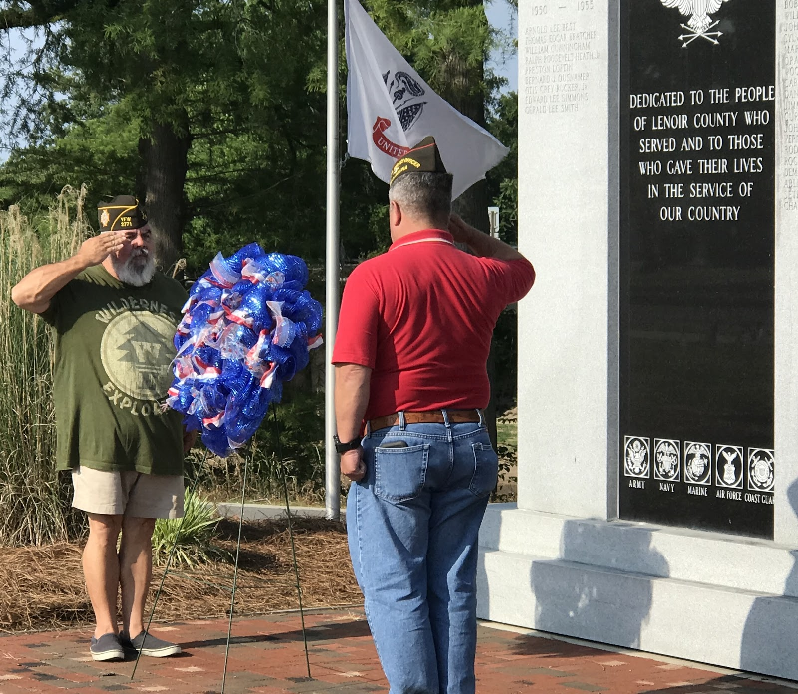 VFW Post 2771 Members salute a remembrance wreath at the Walk of Honor on Heritage Street.