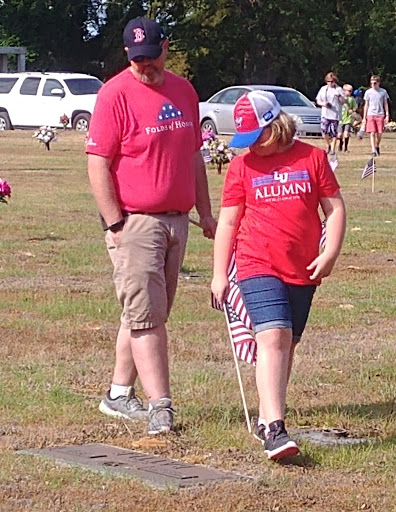 The author and his daughter (Alexis Towne) placing flags at Pinelawn Memorial Park.