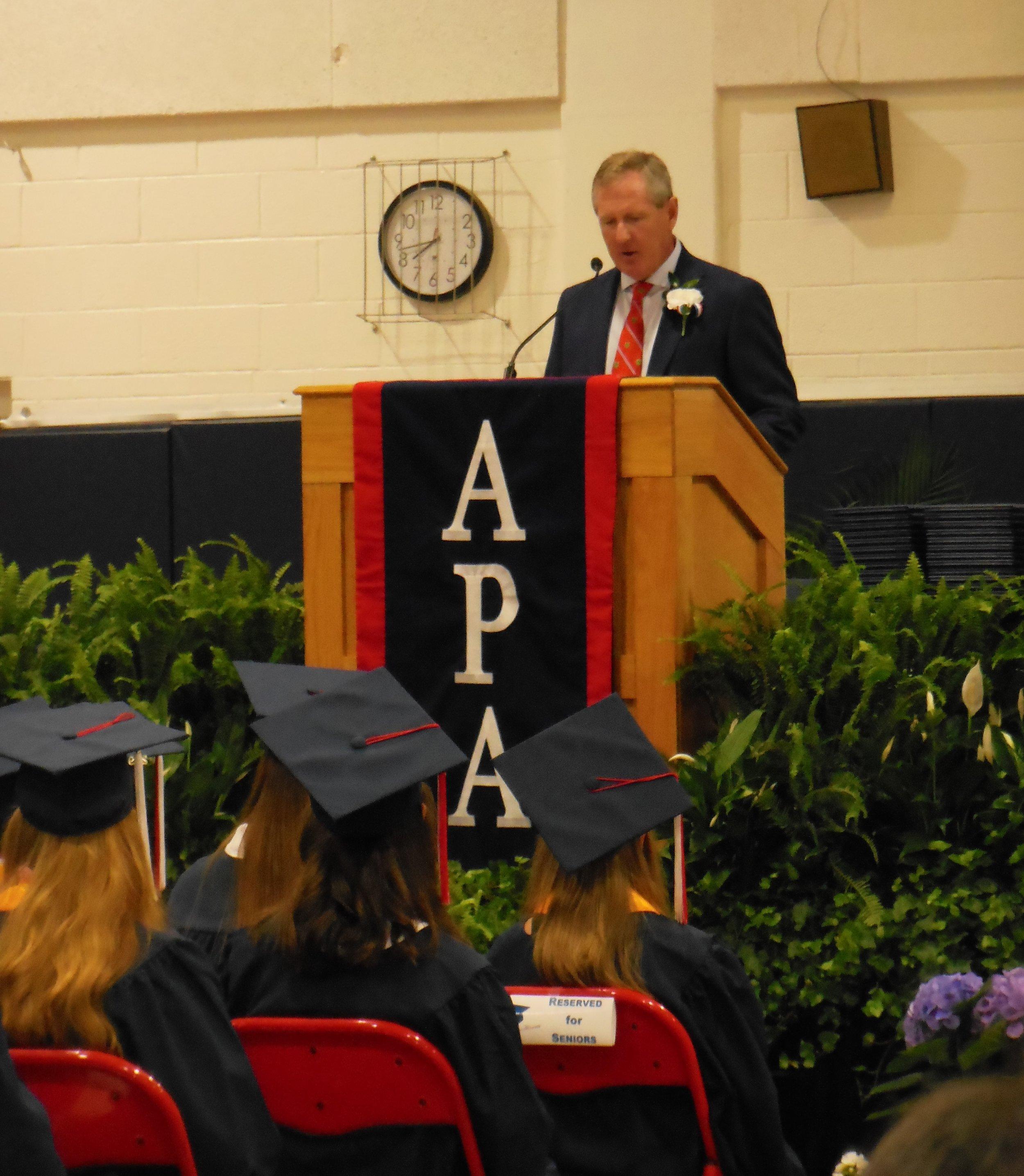 "Parrott Board of Trustees president Stuart Lindley advises graduates, ""Do not settle. Do what you love."""