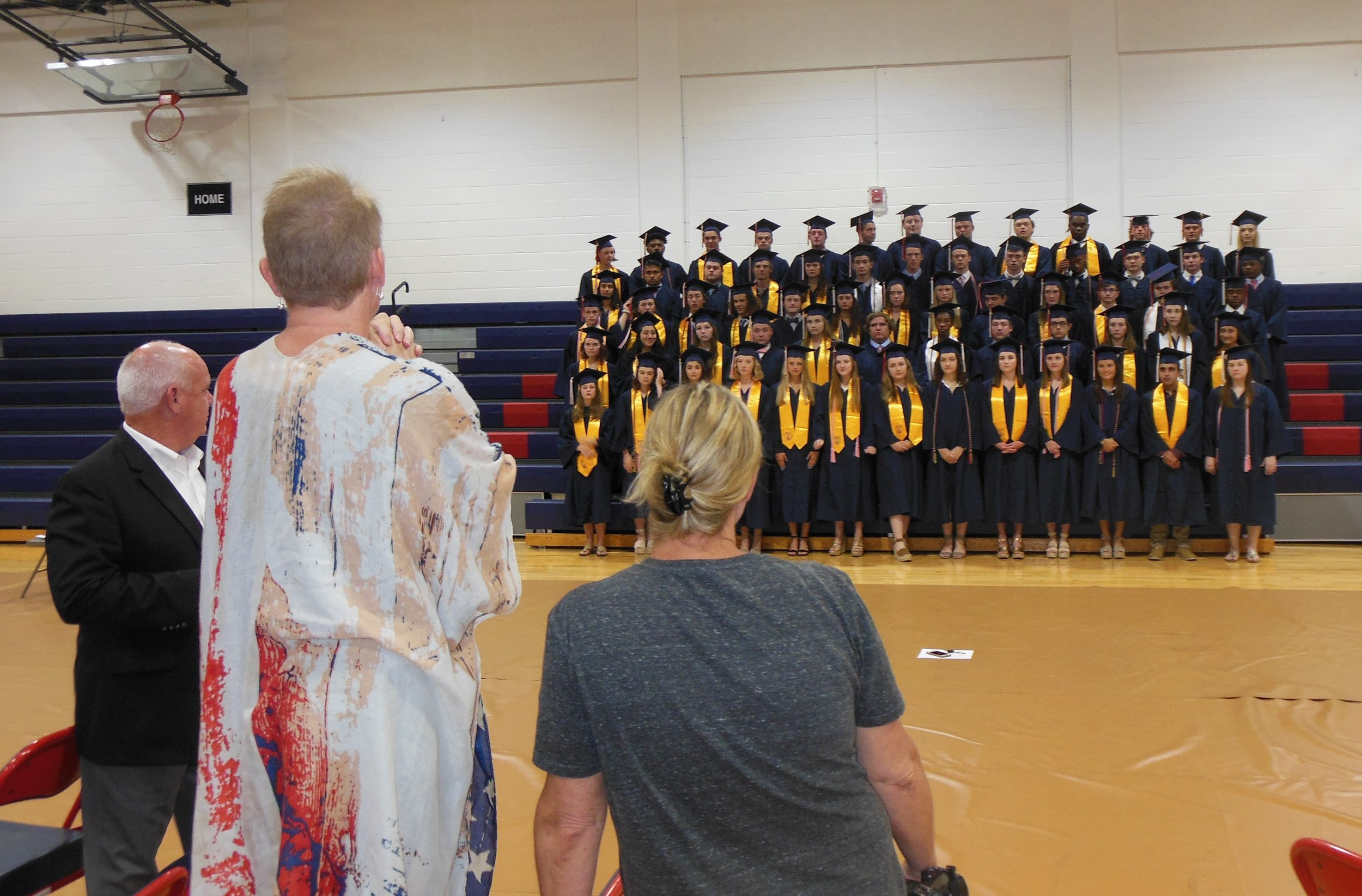 Before their big night, seniors at graduation practice line up for a class photo while Headmaster Bert Bright and teachers Staci Basden and Melissa Lambert give directions.