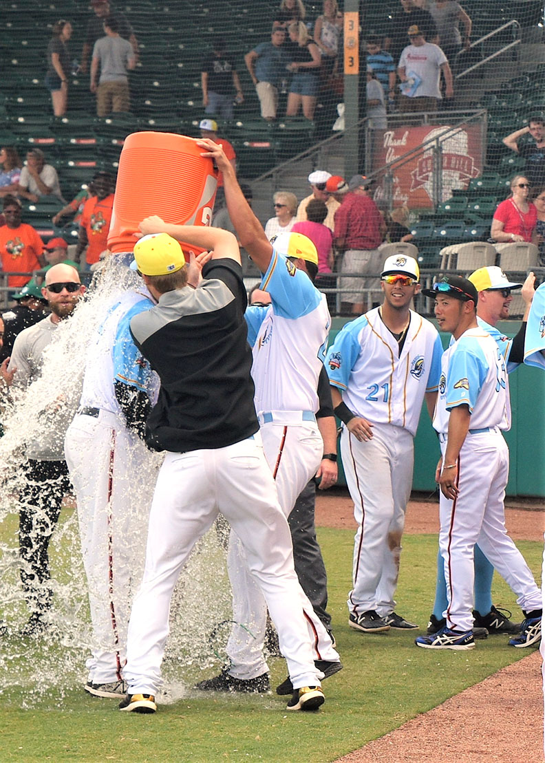 The Wood Ducks douse their manager, Corey Ragsdale, with Gatorade during the post-game celebration on the field. Photo by William 'Bud' Hardy / Neuse News
