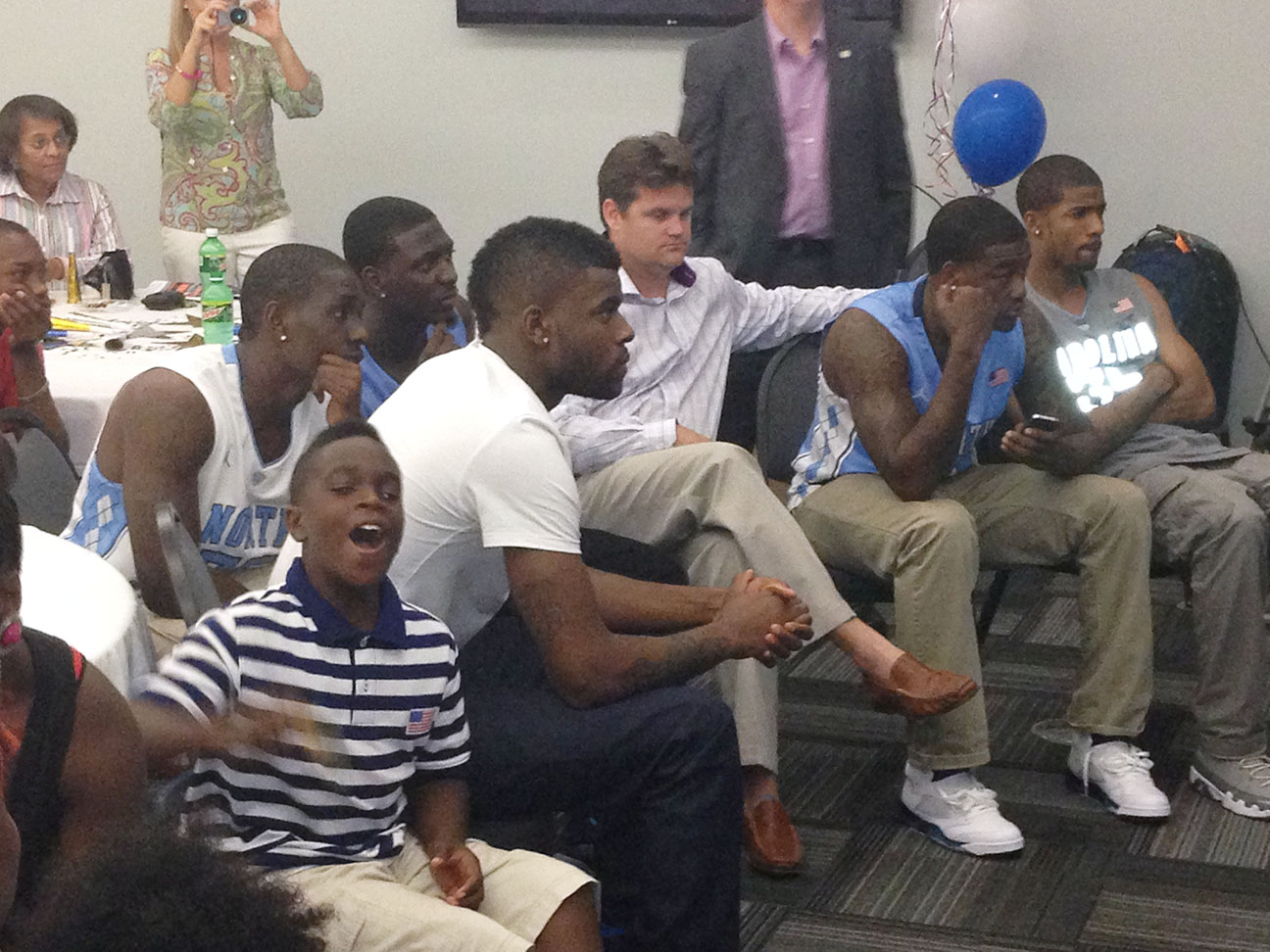 Reggie Bullock, center, waits for his name to be called during an NBA Draft party at the Woodmen Community Center on June 27, 2013. He was selected by the Los Angeles Clippers with the 25th pick of the first round. Photo by Bryan Hanks / Neuse News