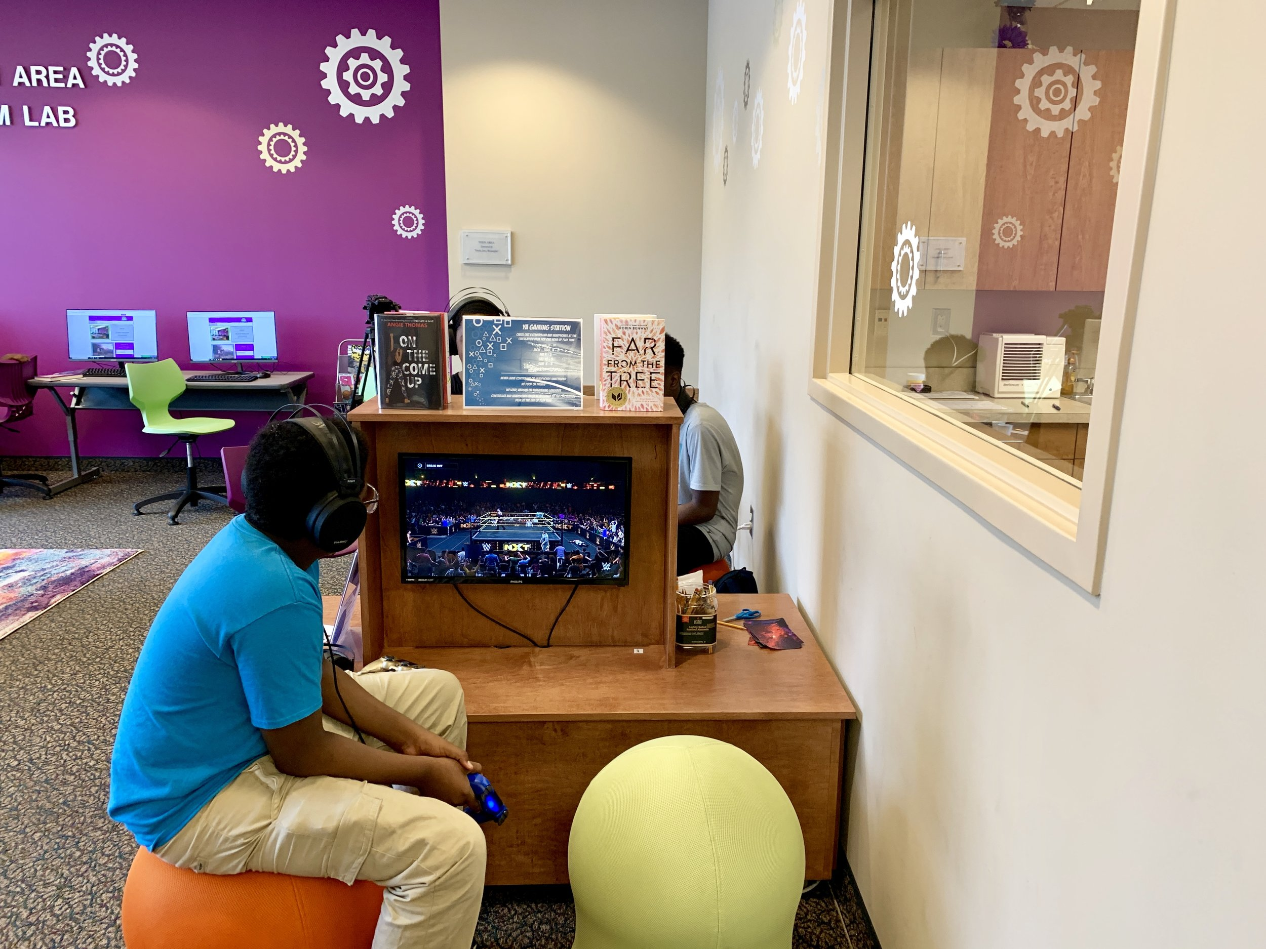 Kemaun Pridgen plays a video game in the new Teen Area at the Kinston-Lenoir Public Library on Thursday Photo by Catherine Hardee / Neuse News