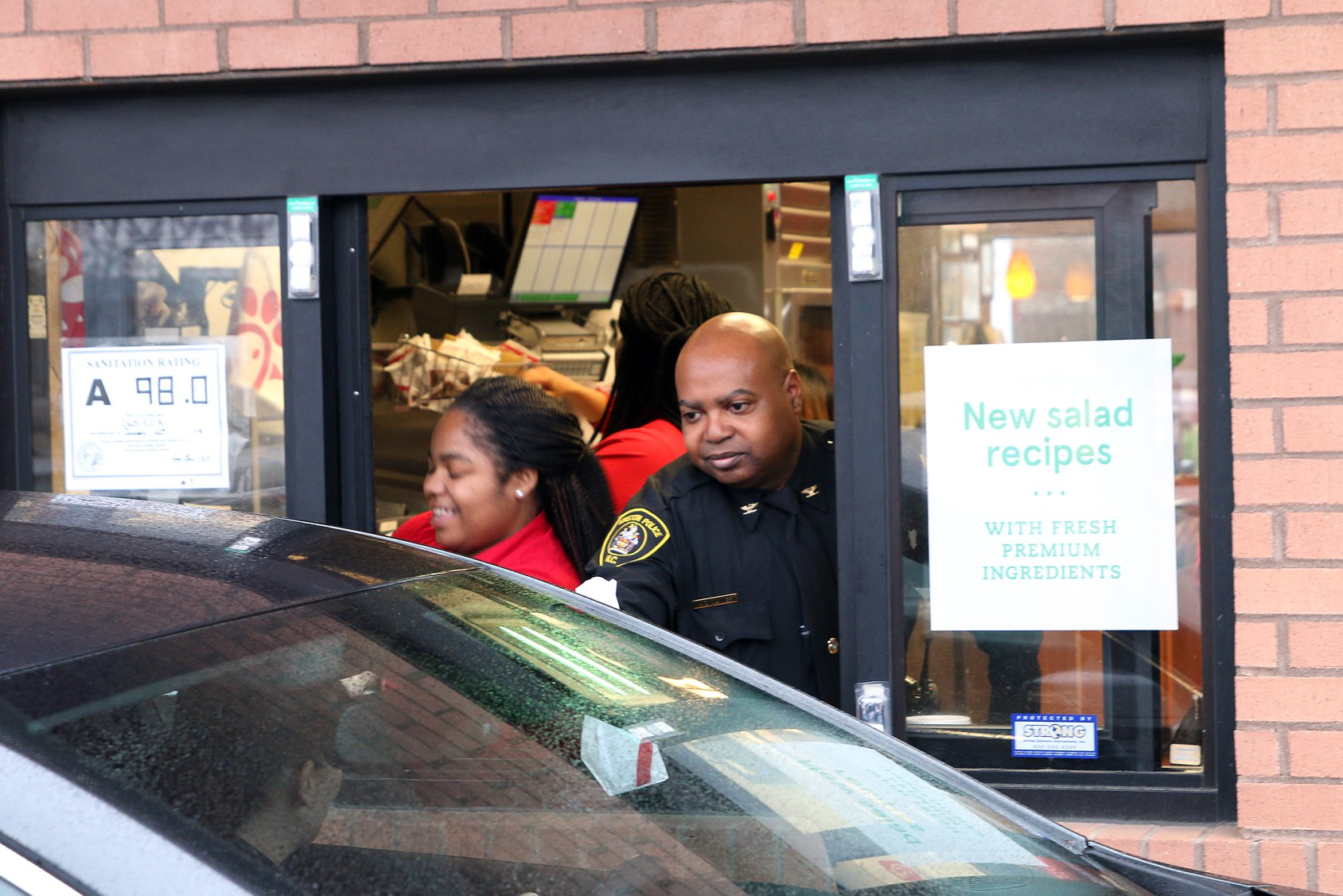 Kinston Police Chief Alonzo Jaynes works the drive thru window during a community relations event held at Chick-fil-A. Submitted photo.