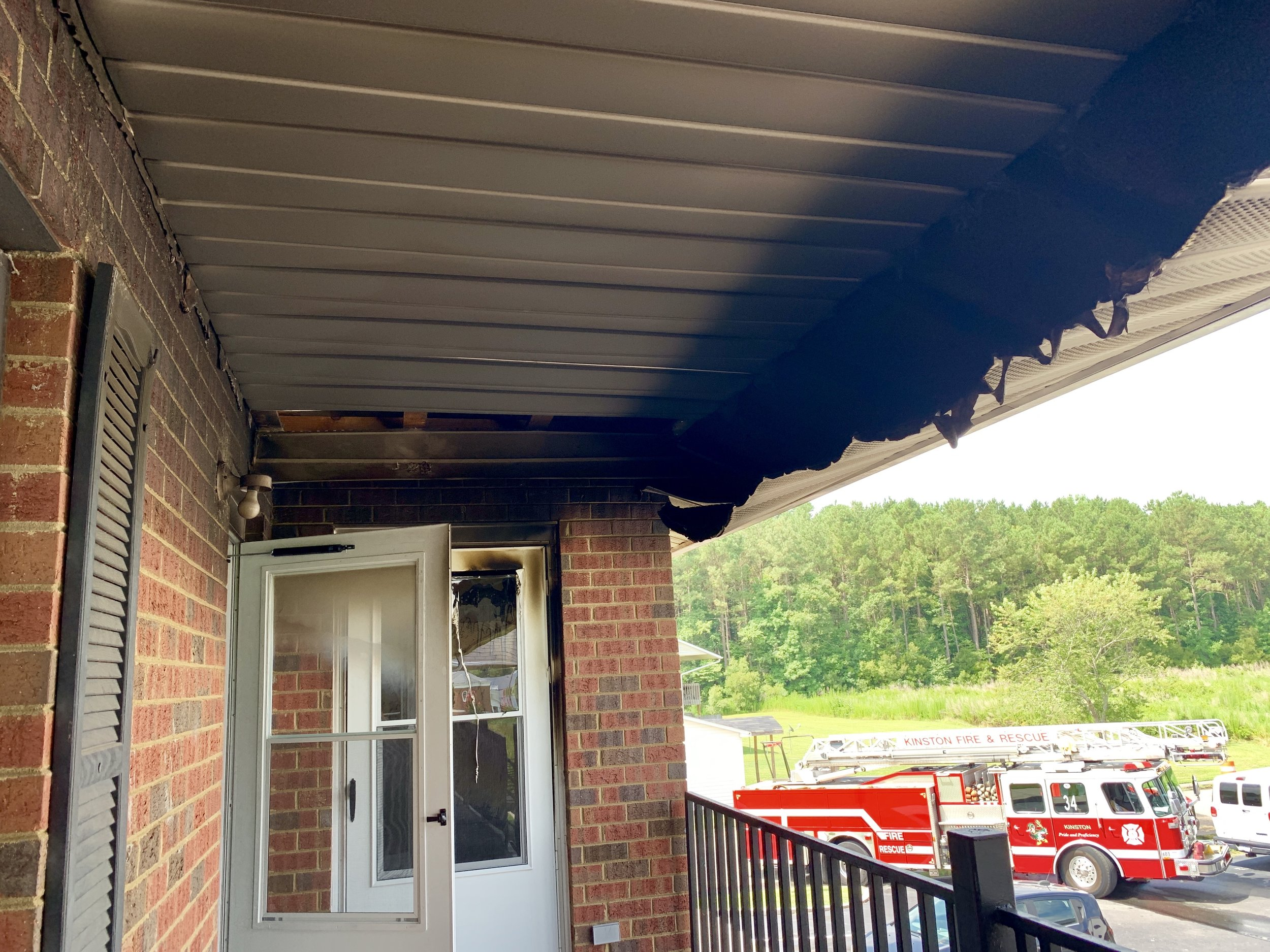 Fire damage is visible on the door of the apartment where a kitchen fire broke out Tuesday morning. Photo by Catherine Hardee / Neuse News