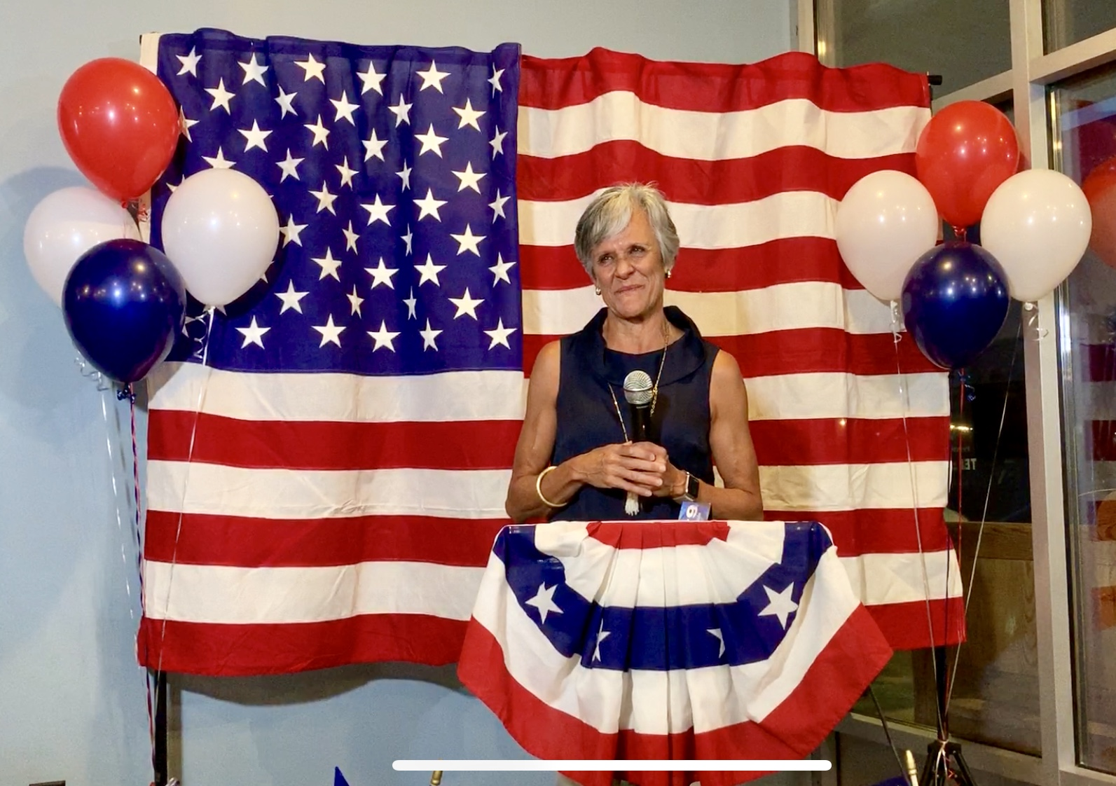Dr. Joan Perry speaks to supporters after learning the results of the election .Photo by Catherine Hardee / Neuse News