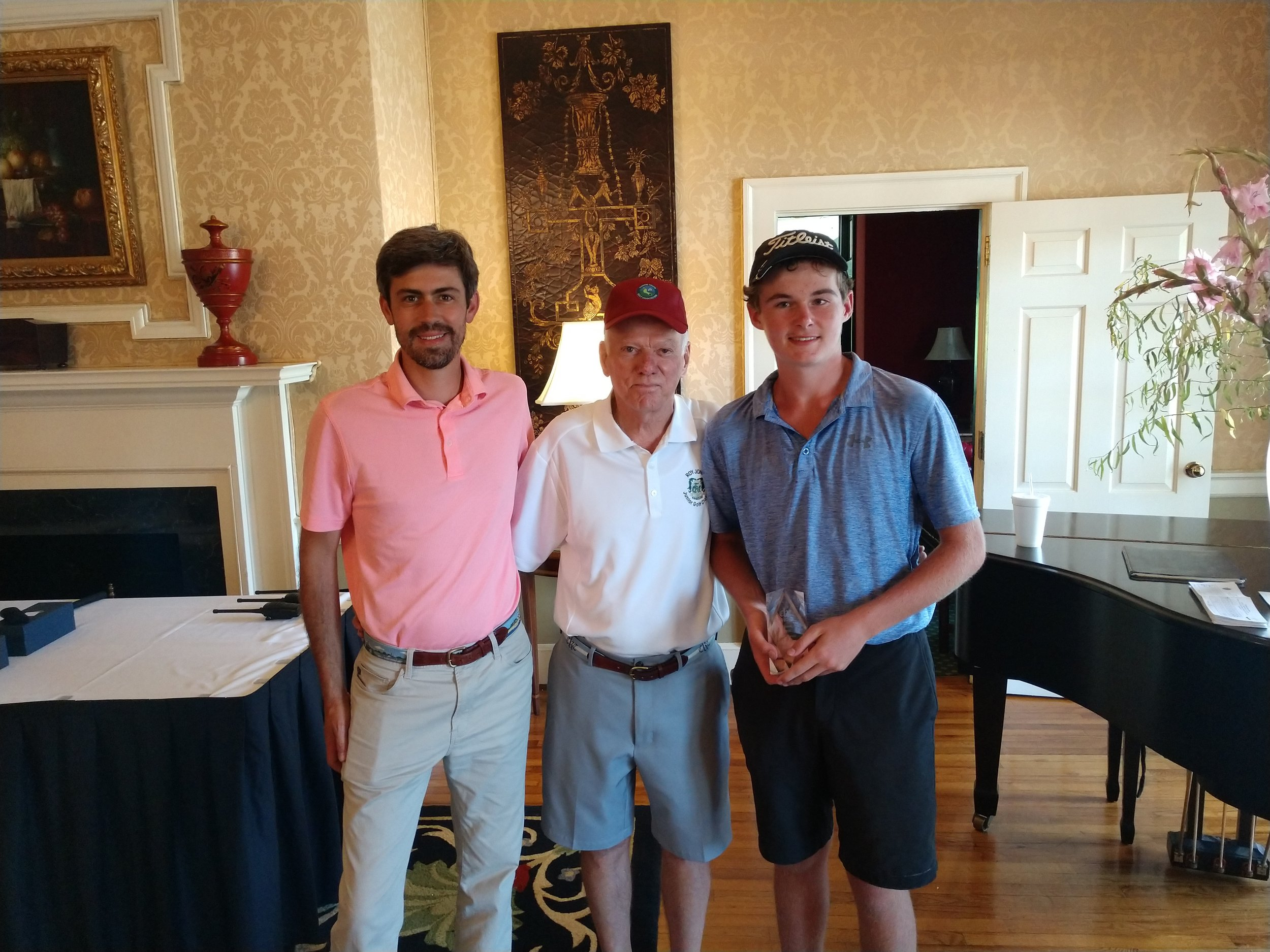 Matthew Richarson, right, finished third in the 14-15 year old boys' division in the Roy Jones Junior Golf Classic, which ended Wednesday. Standing next to Richardson is, from left, golf professional Jason York and tournament founder Roy Jones Jr. Photo by Junious Smith III / Neuse News