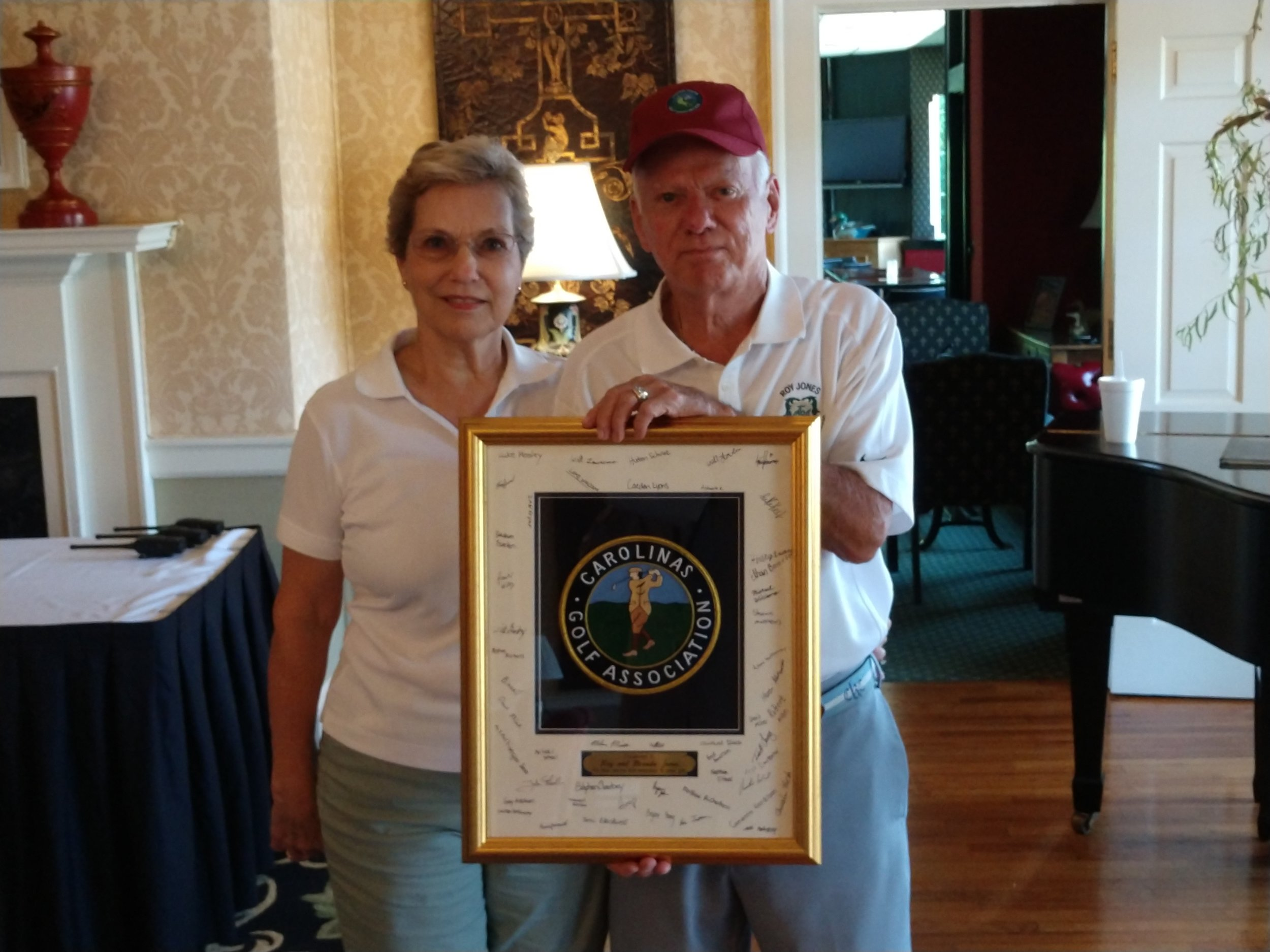 Roy Jones Jr. and his wife, Brenda, received a plaque from the Carolina Golf Association for their work growing the Roy Jones Junior Golf Classic over the years. Photo by Junious Smith III / Neuse News