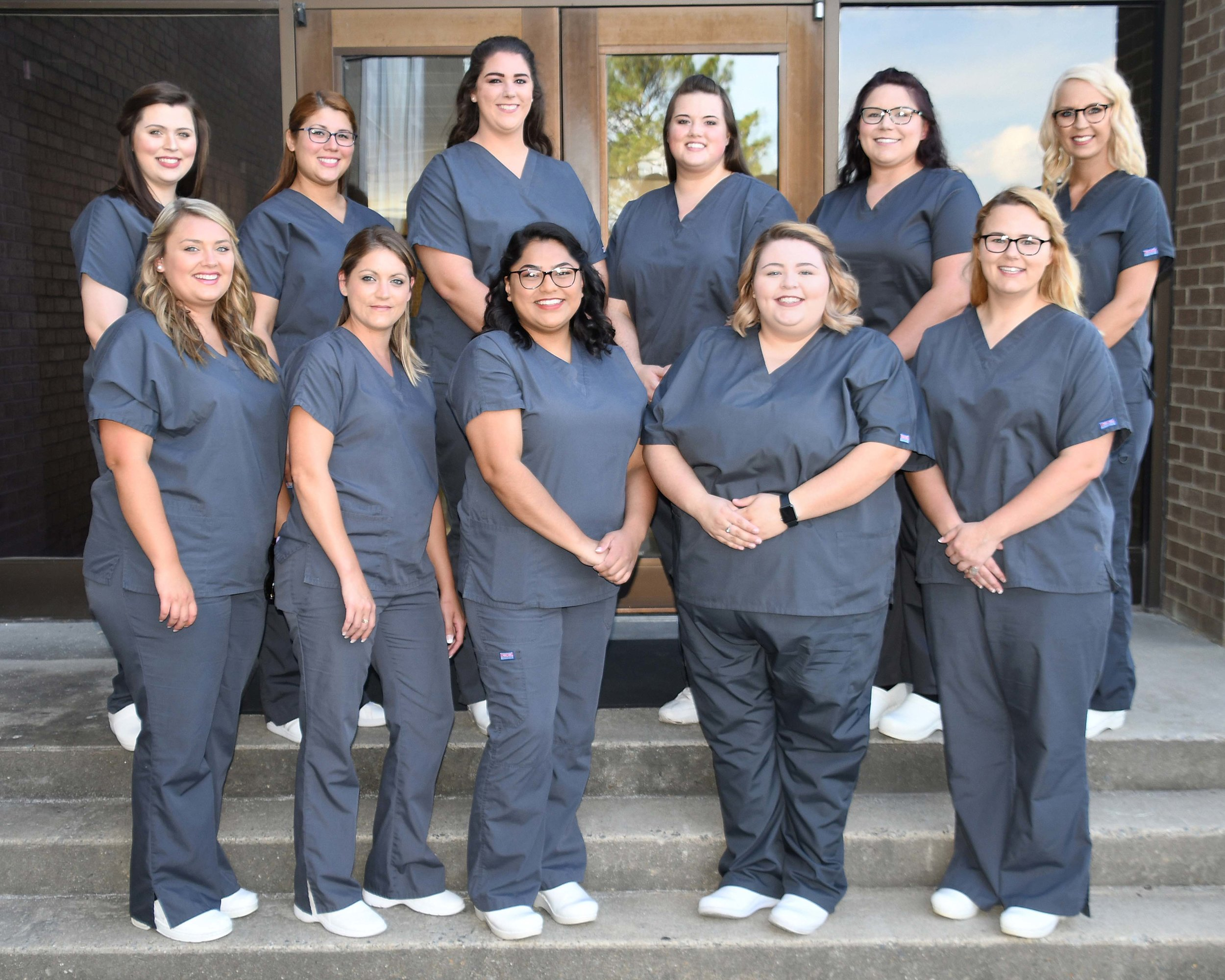 SURGICAL TECHNOLOGY CLASS OF 2019  – Pictured left to right, front row, are Natalie Dudley of Vanceboro, Kimberly Rogerson of Winterville, Ana Garcia-Mendez of Kinston, Macayla Vandiford of La Grange, and Jessica Paige Kennedy of Deep Run; back row, Katie Twigg of Kinston, Claudia Coronado Moore of Kinston, Katie Smith of Trenton, Jordi Manuel of Kinston, Payton Best of Goldsboro, and Kaitlyn Napier of Snow Hill.