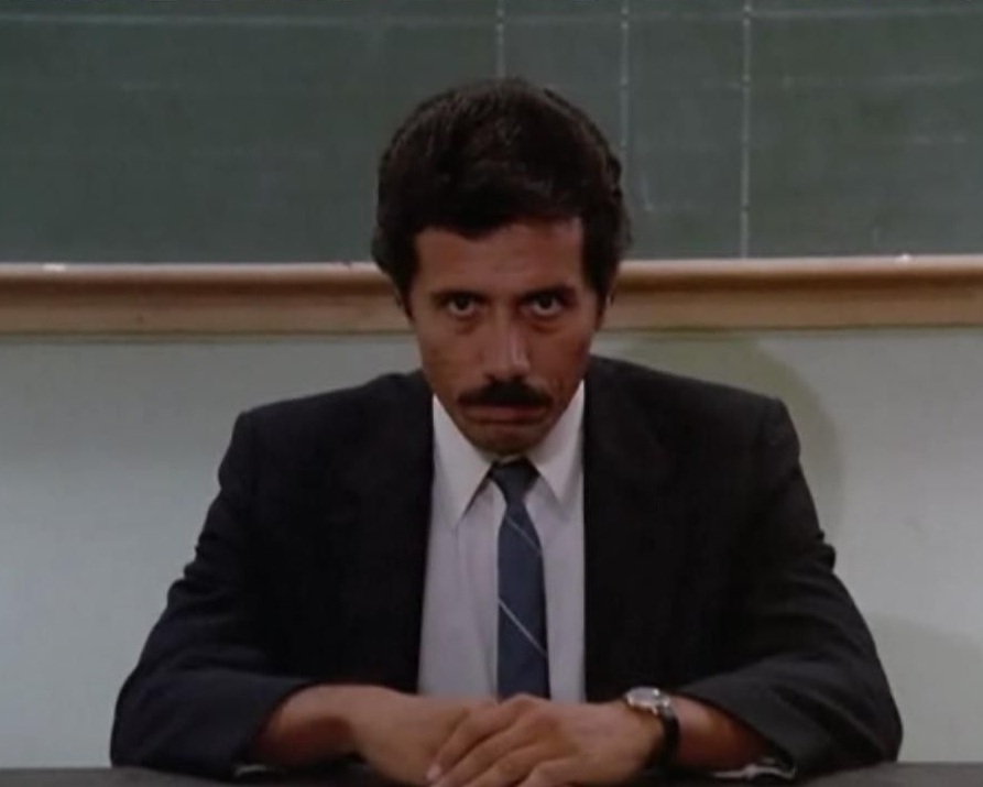 Edward James Olmos enjoys a lighthearted moment portraying Lt. Martin Castillo on Miami Vice / NBC