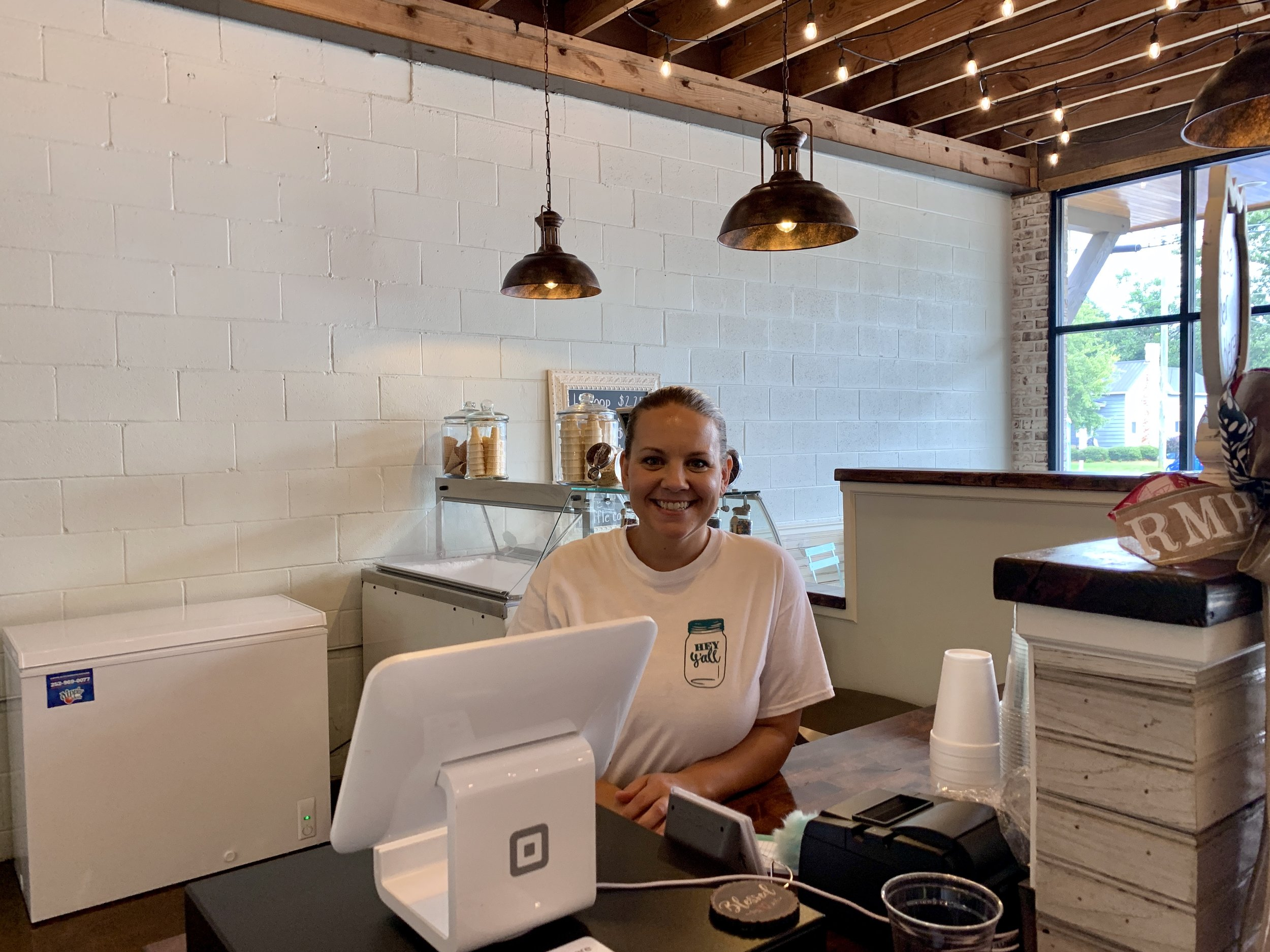 Ashley Smith stands behind the counter of her new restaurant in Deep Run. Photo by Catherine Hardee / Neuse News