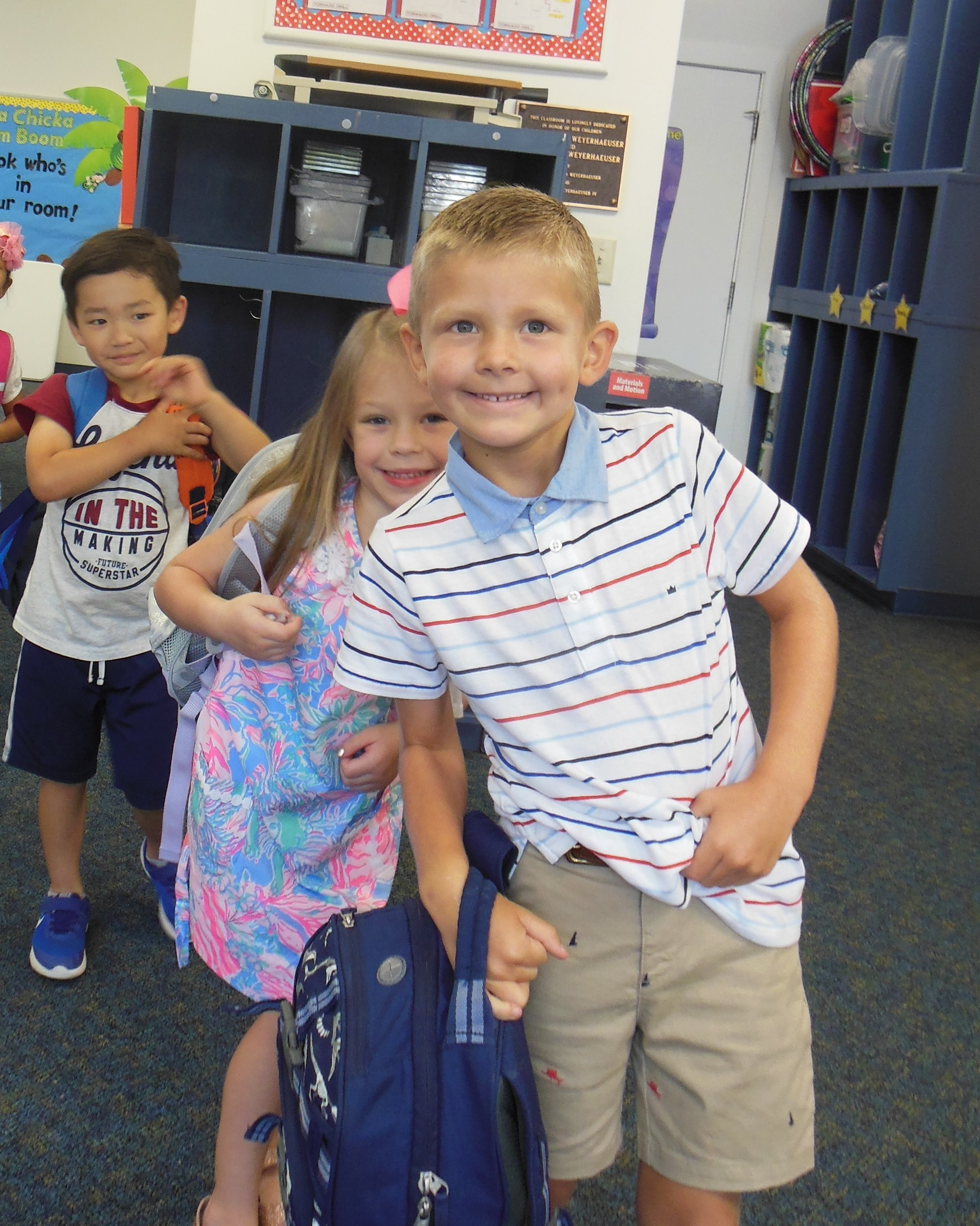 On their first day of kindergarten, these Parrott students are excited to line up for class. Left to right: Josiah Kim, Kalee Barfield, and Noah Brinson.