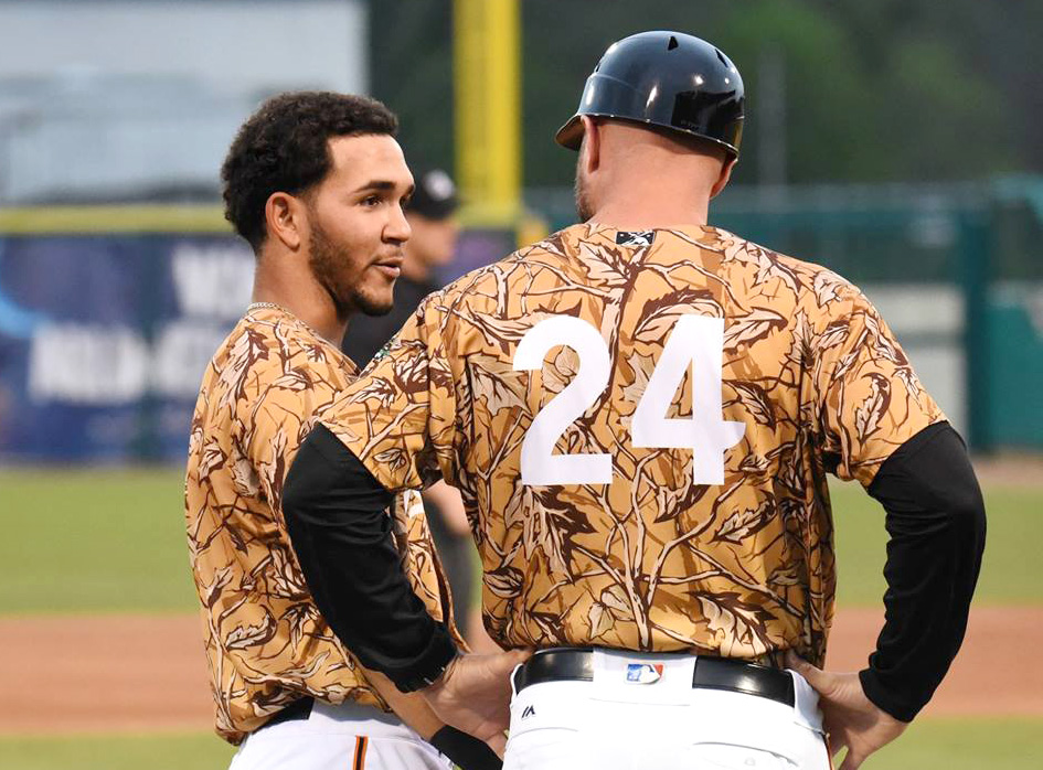 Anderson Tejeda, left, chats with Wood Ducks manager Corey Ragsdale at third base during a game in the first half. Tejeda was one of the integral parts of the team that helped lead the Woodies to a 50-20 first half mark. Photo by William 'Bud' Hardy / Neuse News