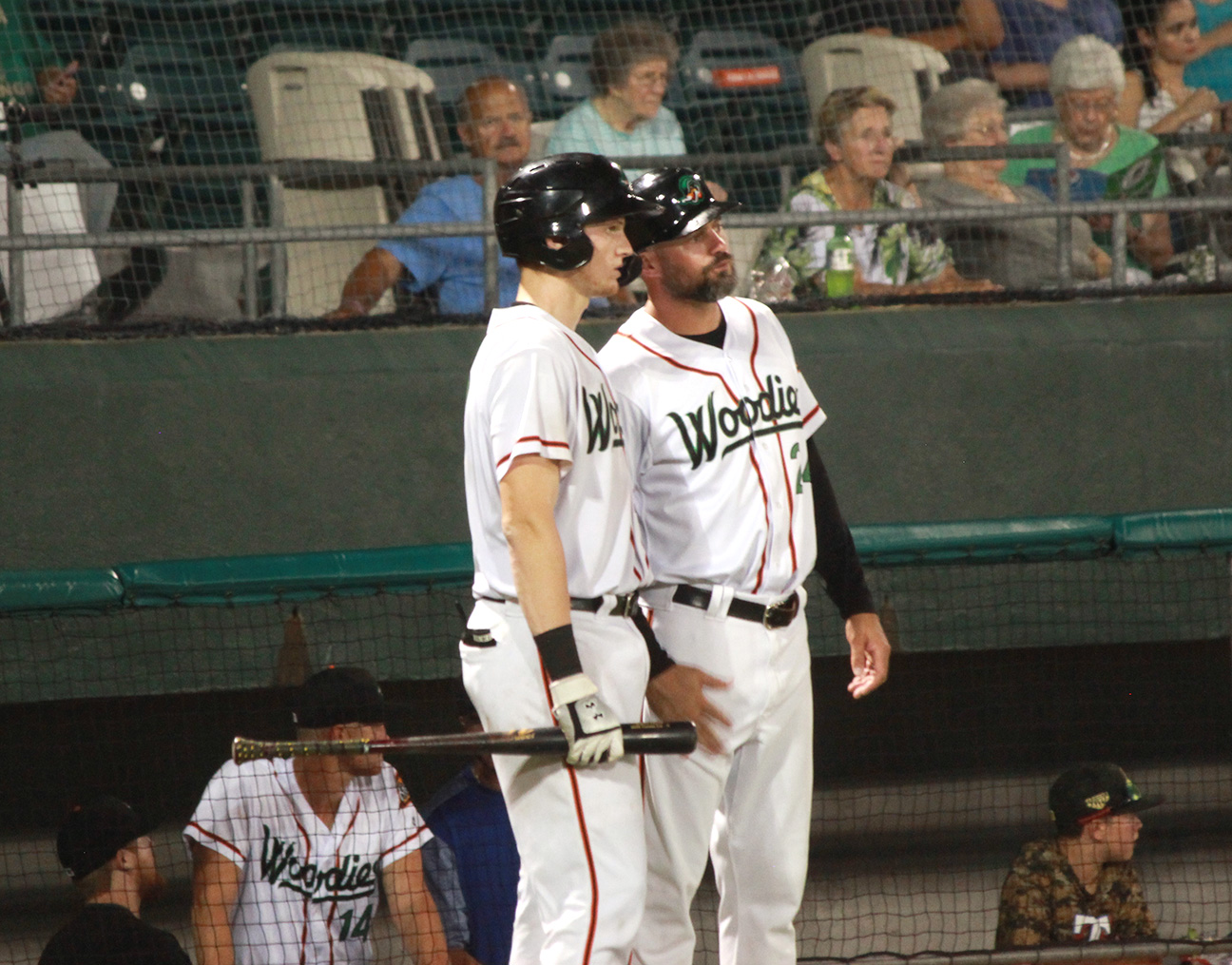 Down East Wood Ducks manager Corey Ragsdale, right, chats with catcher Sam Huff during a game at Historic Grainger Stadium on Tuesday. Photo by Linda Whittington / Neuse News