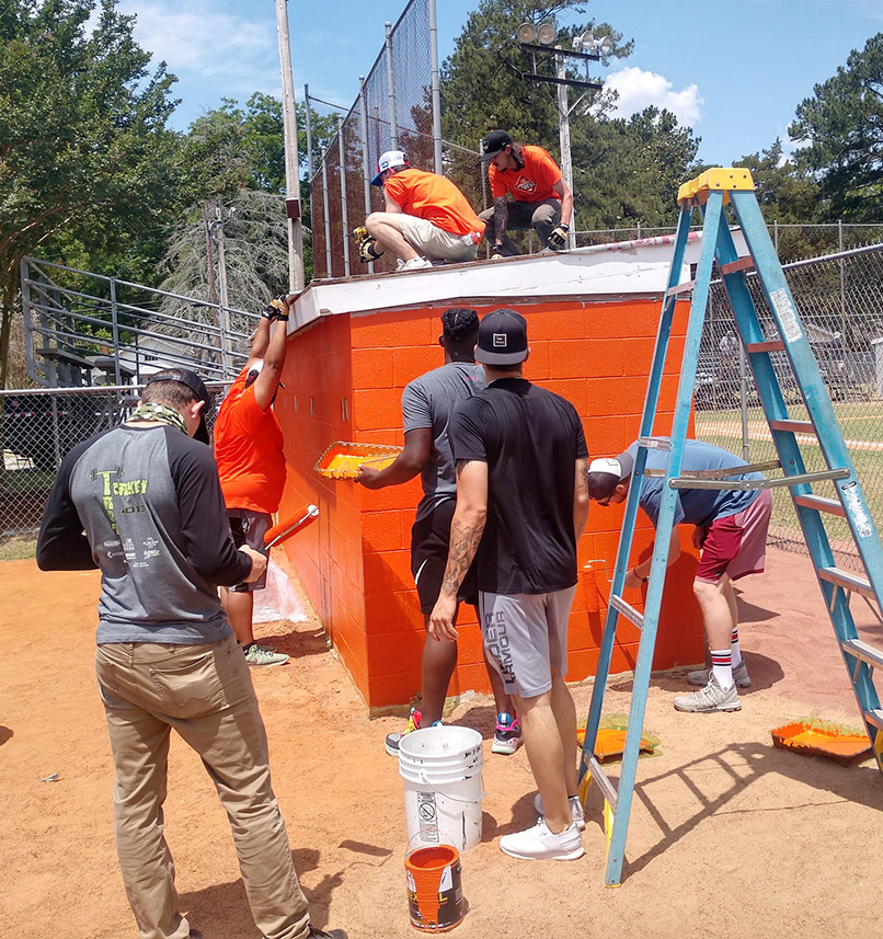 Down East Wood Ducks players used their off day on May 28 to help refurbish Fairfield Park in Kinston. Photo by Junious Smith III / Neuse News
