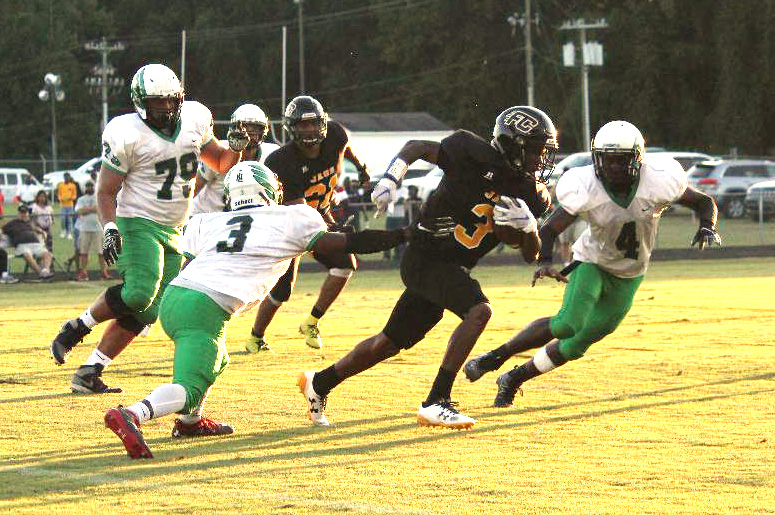 The North Lenoir defense, led by Savion White (3) and Ny'jai Koonce (4), closes in on Farmville's Wesley Day (3) during Friday's game. Photo by Linda Whittington / Neuse News