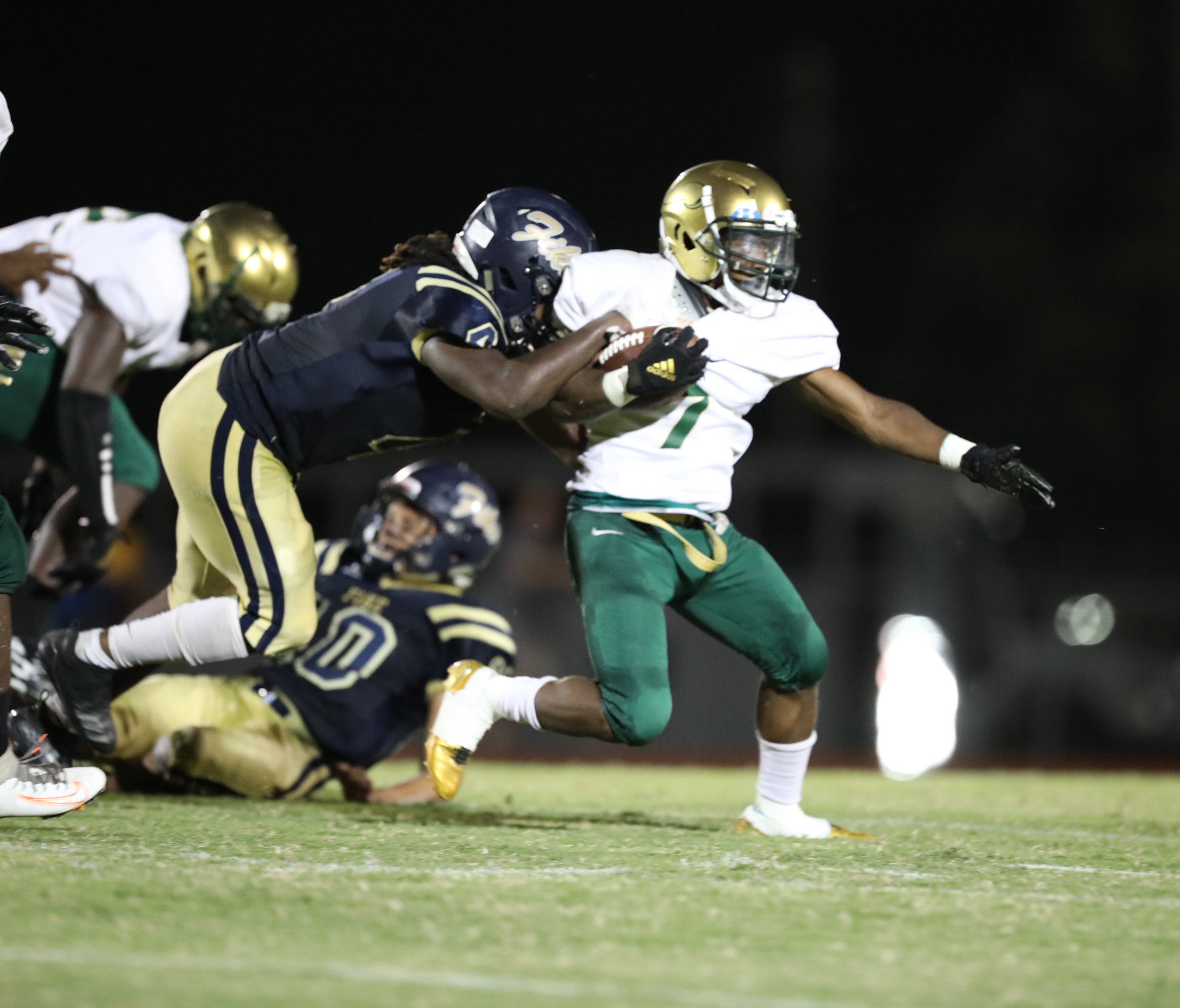 Iverson Ward, Kinston's leading rusher, attempts to break out of a Fike tackle attempt during the Vikings' 35-21 loss on Fike turf Wednesday night. Sheldon Vick   The Wilson Times