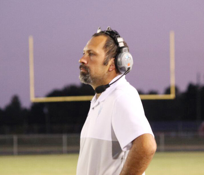 With a beautiful sky behind him, South Lenoir head football coach Jeremy Joyner led his Blue Devils to victory Friday night. Photo by Linda Whittington / Neuse News