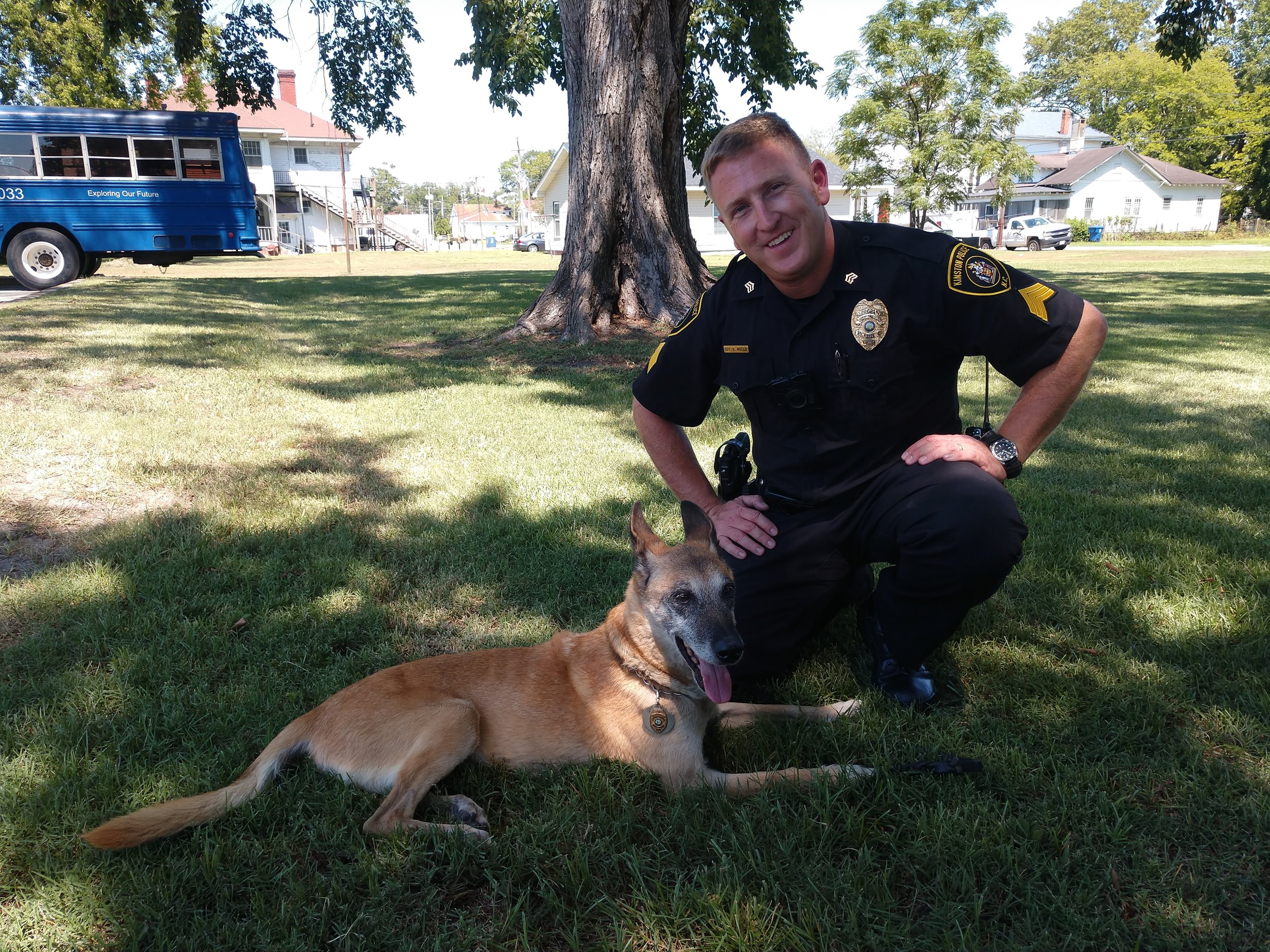 Sgt Brandon Wells with retired K-9 Jessi. Click on the photo for our story on Sept. 2. Photo by Junious Smith III / Neuse News