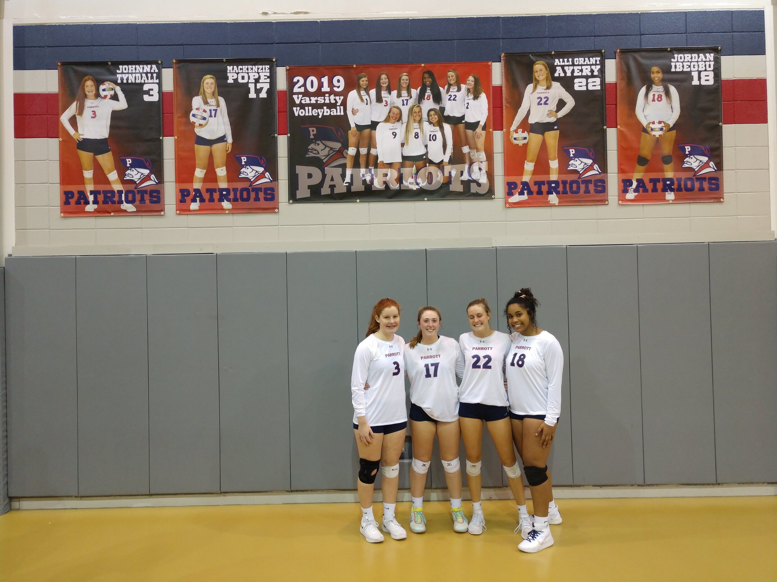 Arendell Parrott's seniors, from left, Johnna Tyndall, Mackenzie Pope, Alli Grant Avery and Jordan Ibegbu enjoyed a win in their final regular-season home game Tuesday. Photo by Junious Smith III / Neuse News