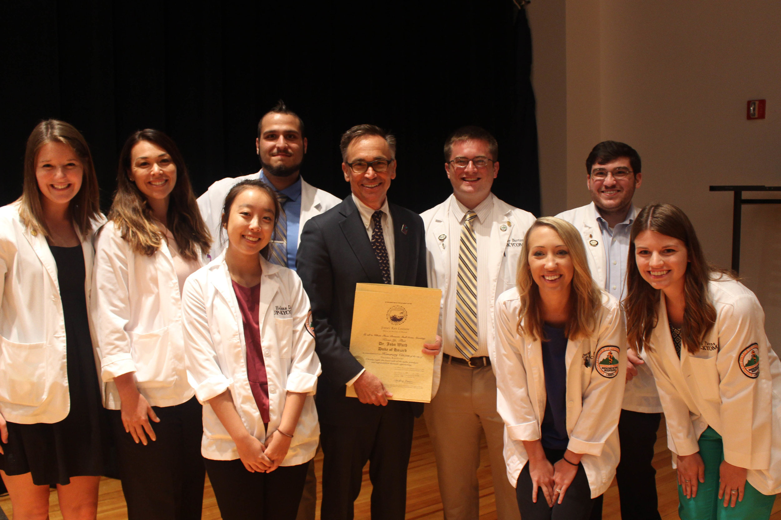 Dr. John Ward with Med school volunteers.JPG
