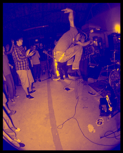 Taking a leap during a performance in Baton Rouge, LA at The Warehouse at HTGT Thrift