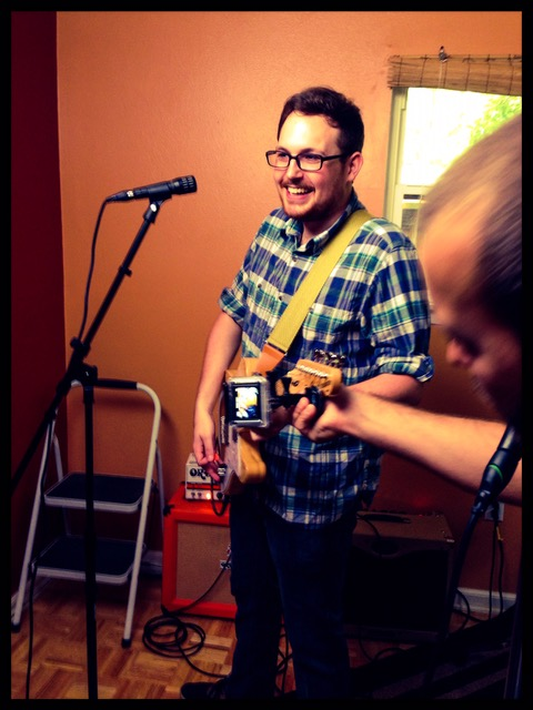 Mounting a go-pro onto Aidan's guitar for an isolated shot