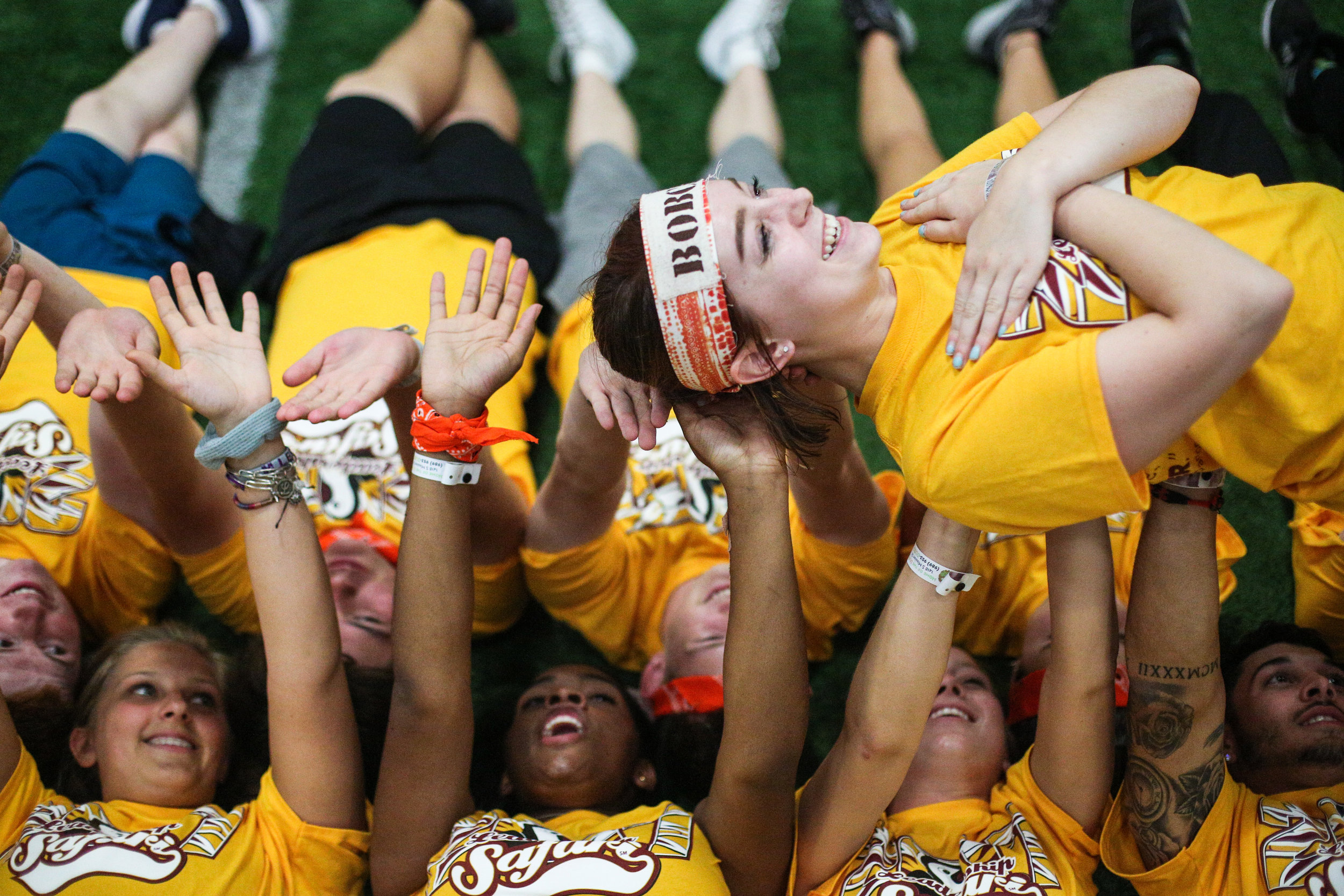Toledo, Ohio freshman Cassie Scouten is passed along by members of the Bobcat and Bearded Dragon teams during a team building exercise at Central Michigan University's Leadership Safari on Aug. 21, 2017 in the Indoor Athletic Complex.