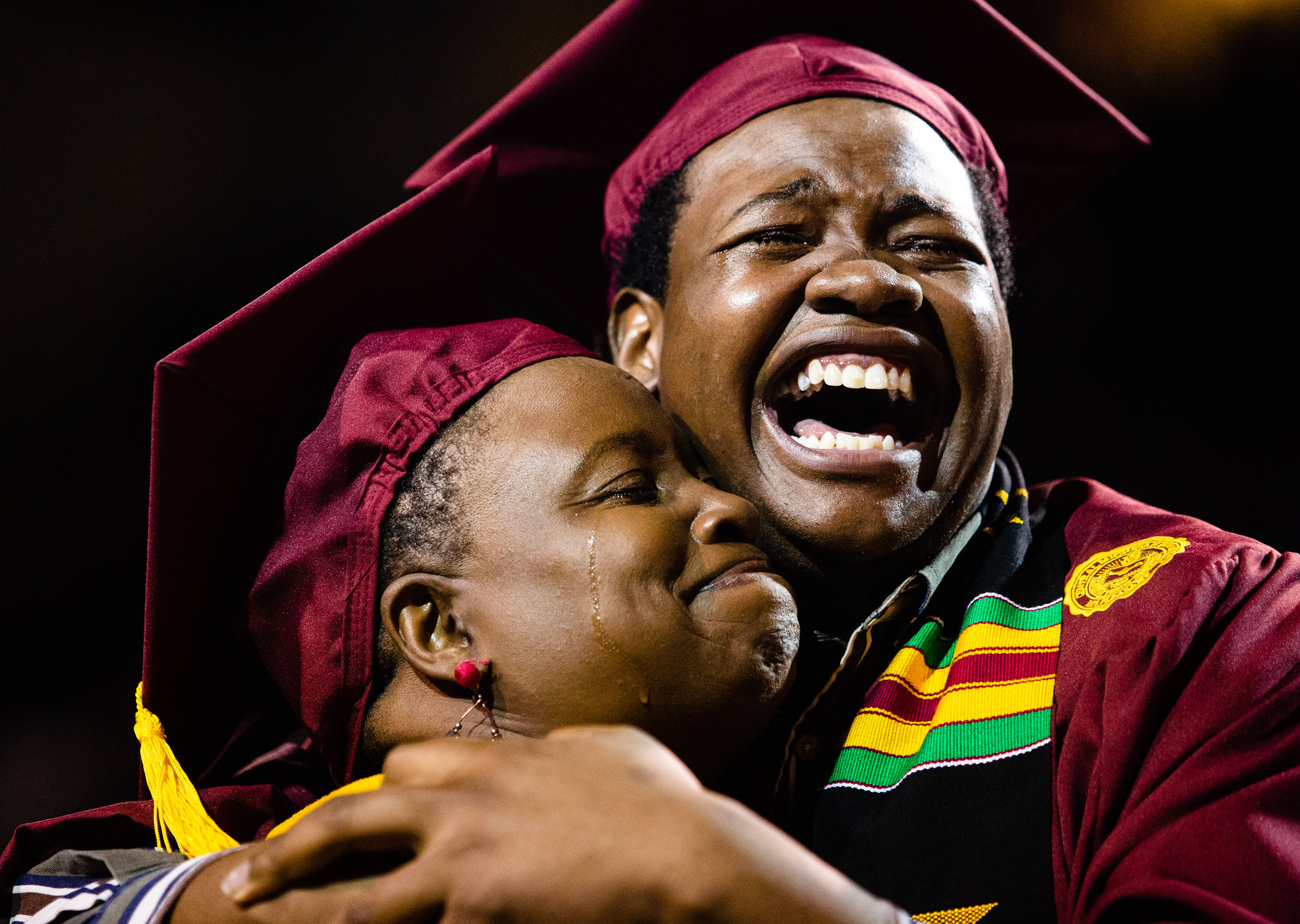 Stephan JoQuan Wilson embraces his mother Sharonda Wilson during his graduation ceremony, May 4, 2019 at Central Michigan University. Sharonda was supposed to be graduating from Ferris State University the same time as Stephan and wasn't going to attend his graduation, but the CMU President brought her out, surprising Stephan, and conferred her degree.