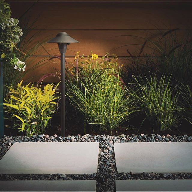 Pathway lighting should be equal parts function and visual appeal. And, by installing high-quality materials, you will ensure longevity and durability, bringing the safety and appeal you desire for years to come! If you are ready to take the step toward transforming your outdoor spaces, we would love to show you how LandLight can help. And...our current spring promotion will likely help you make your decision. (Link in profile) . #landlight.co #lightupyourlandscape #springpromotion