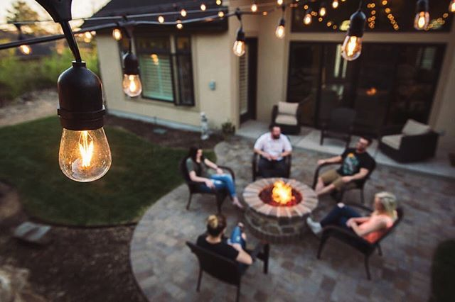 Smiles and good vibes are included with every #LandLight.co project! How could you not just love these Prime Patio string light projects...we can't get enough! AND, we still have an amazing promo running right now (link in bio) that you should take advantage of, if you're considering lighting. . #lightupyourlandscape #backyardvibes #firepit