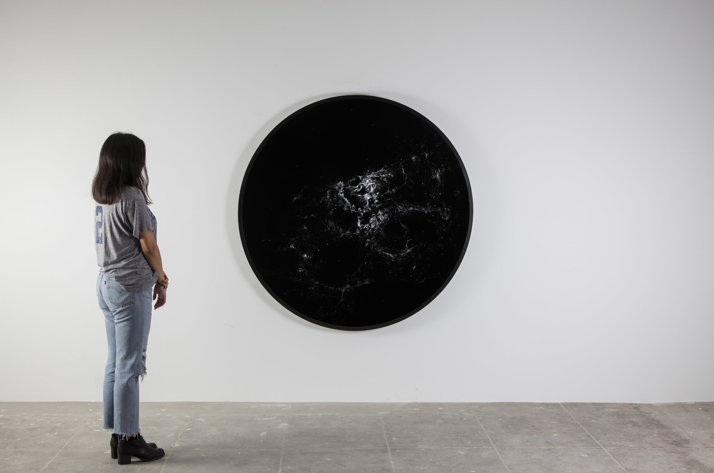 installation view of NGC 2070  2016  cocaine dust on photographer's velvet  60 1/8 inches diameter