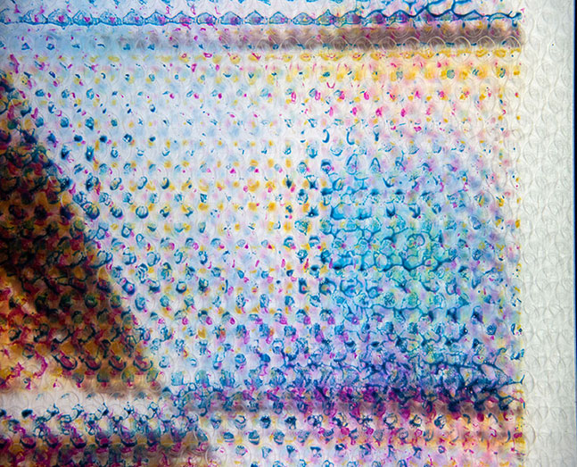detail of GAP 7A  2013  cyan, magenta, yellow and black hair dye on individual layers  of bubble wrap (5 layers total), in LED lightbox aluminum frame  57 x 45 x 3 inches
