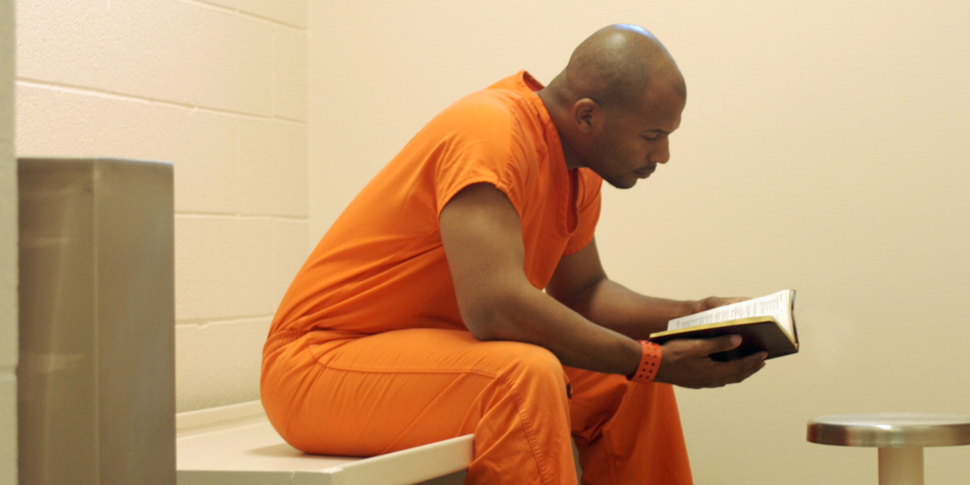 Studying-Bible-in-prison.jpg