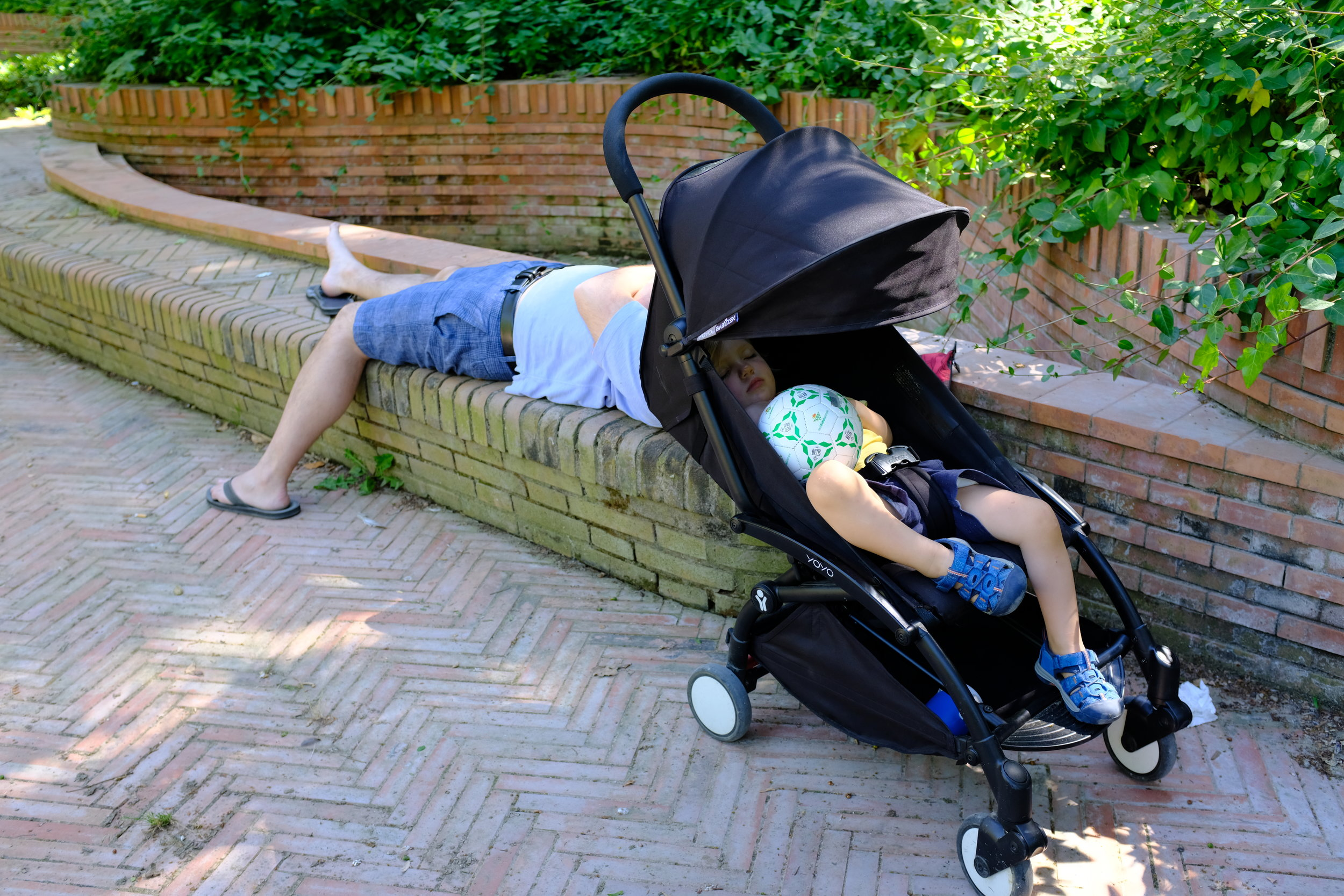 Jimmy and Daddy napping away at Parque de Maria Luisa in Seville, Spain.