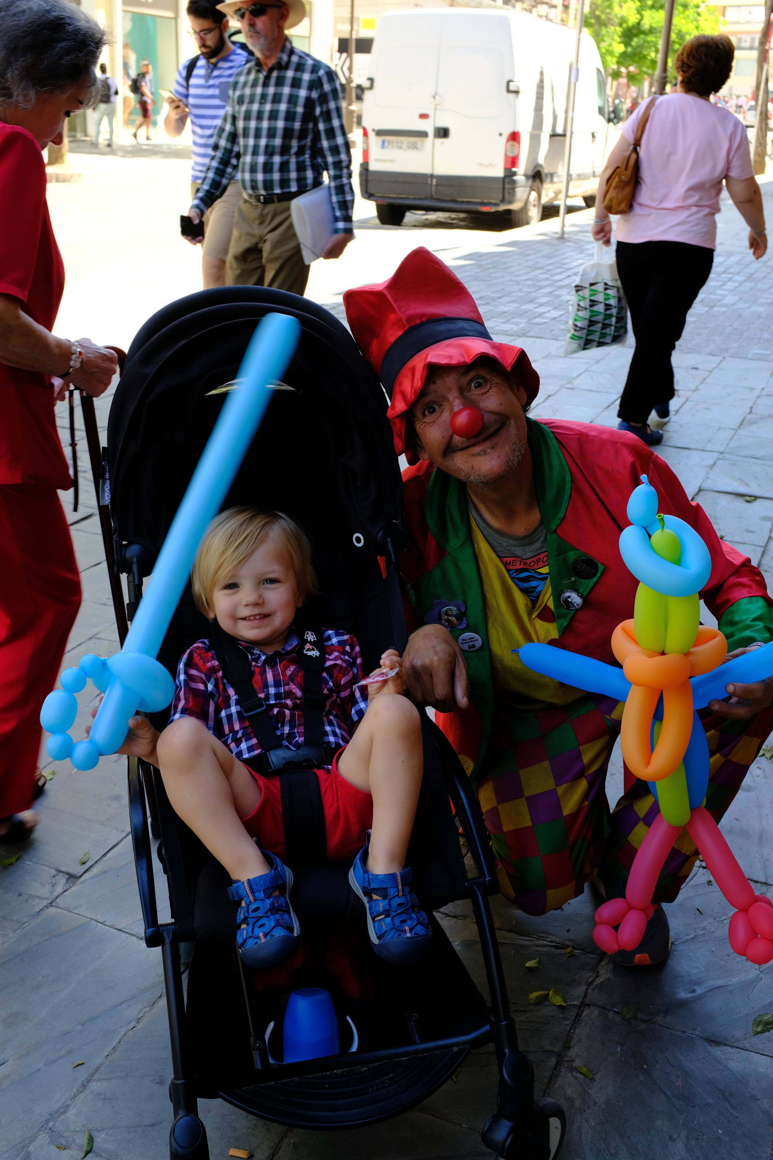 Stopping by to see a street clown in Seville, Spain.