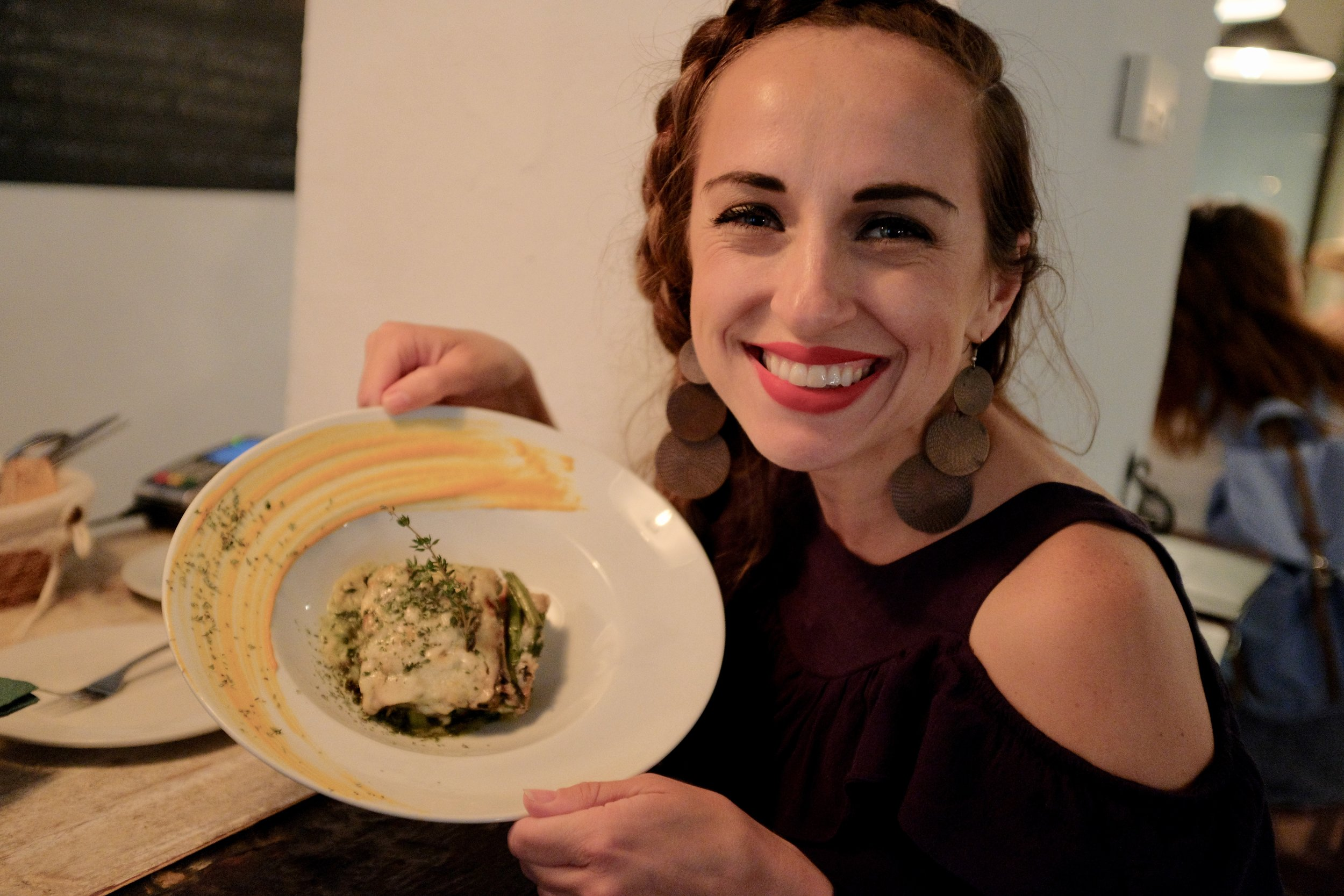 Me eating a fun healthy dish – roasted vegetable lasagna from Mechela Restaurant in Seville, Spain. No pasta at all, only veggies.
