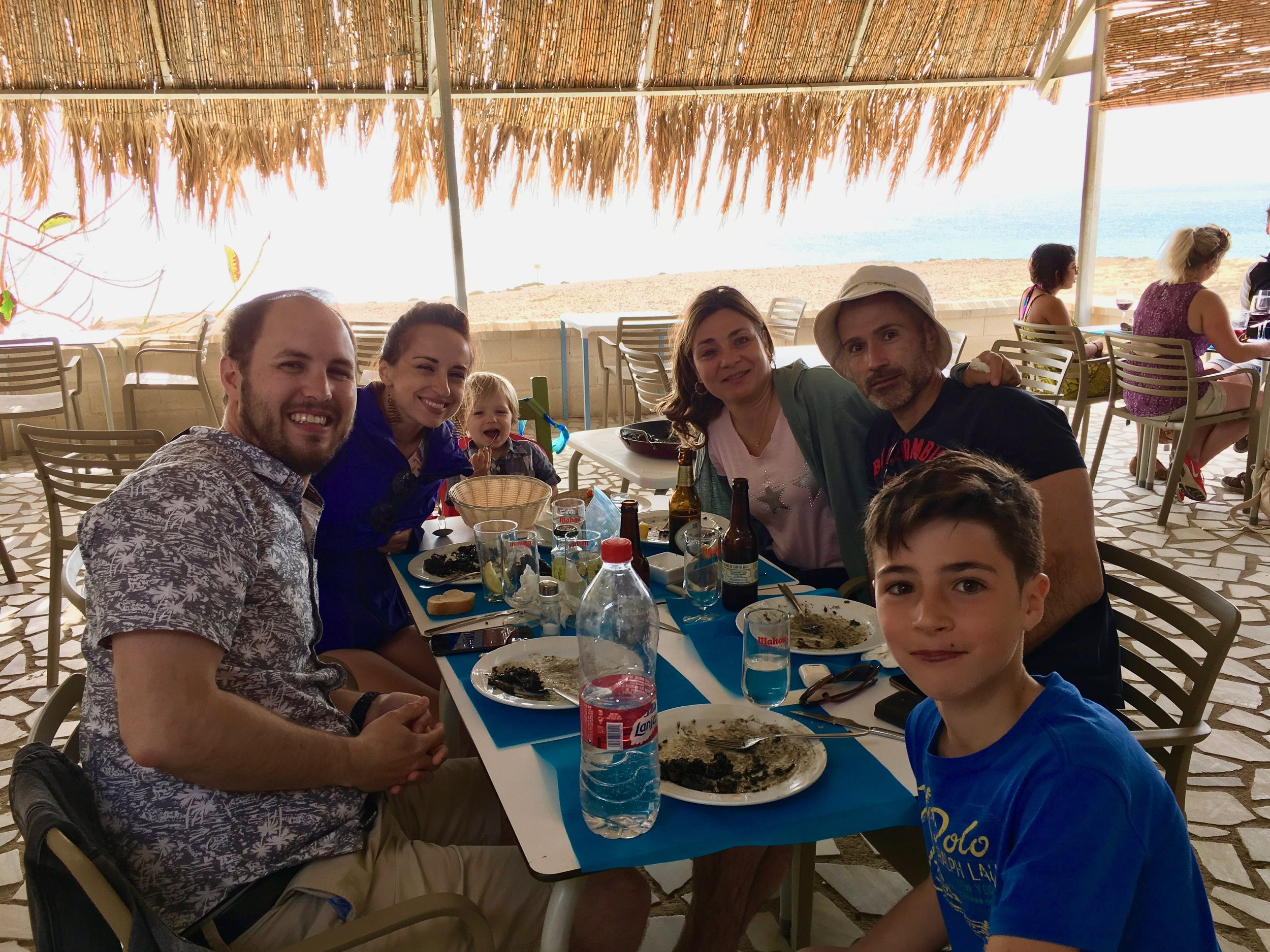 Enjoying lunch on the beach with our dear friends in Almería, Spain.