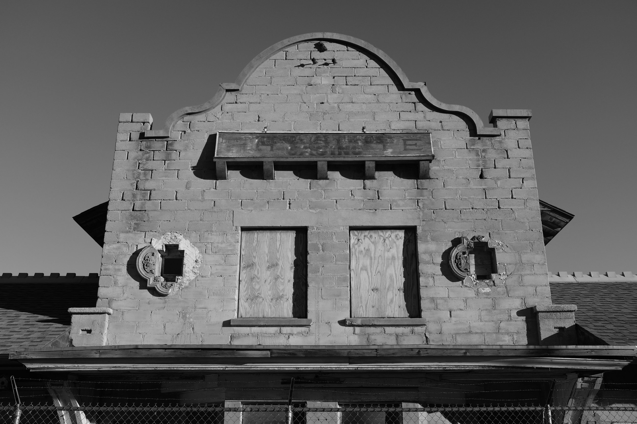 """Rhyolite Train Station- If you look closely at the original letters on the sign, it says, """"Rhyolite."""""""