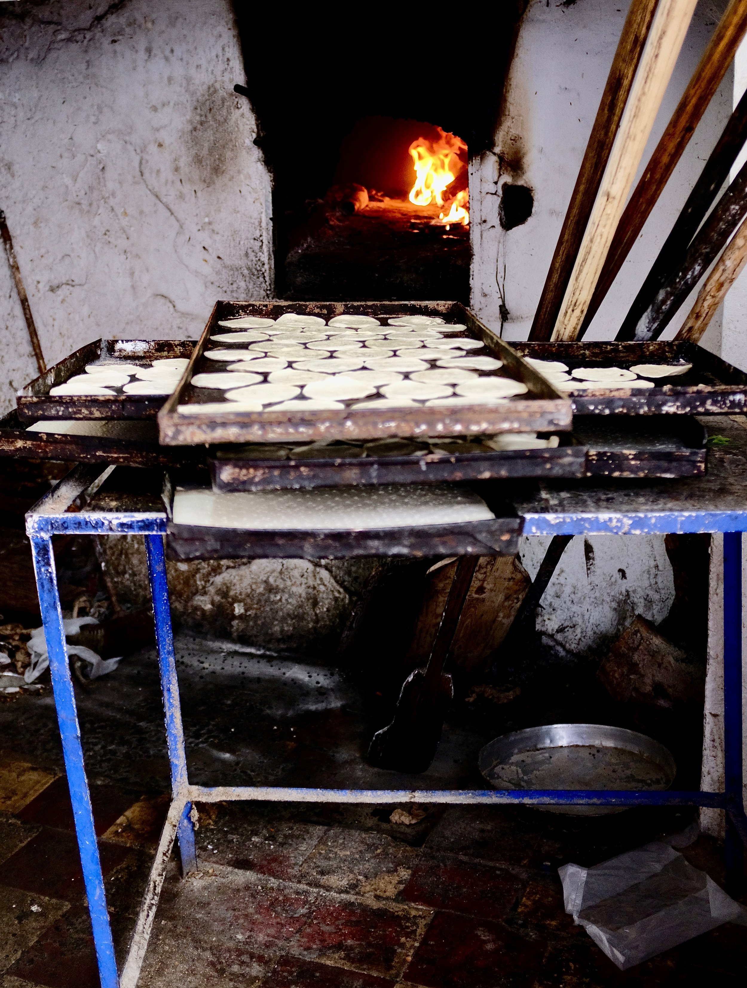Moroccan pastries getting ready to be baked in a communal oven in Chefchaouen, Morocco.