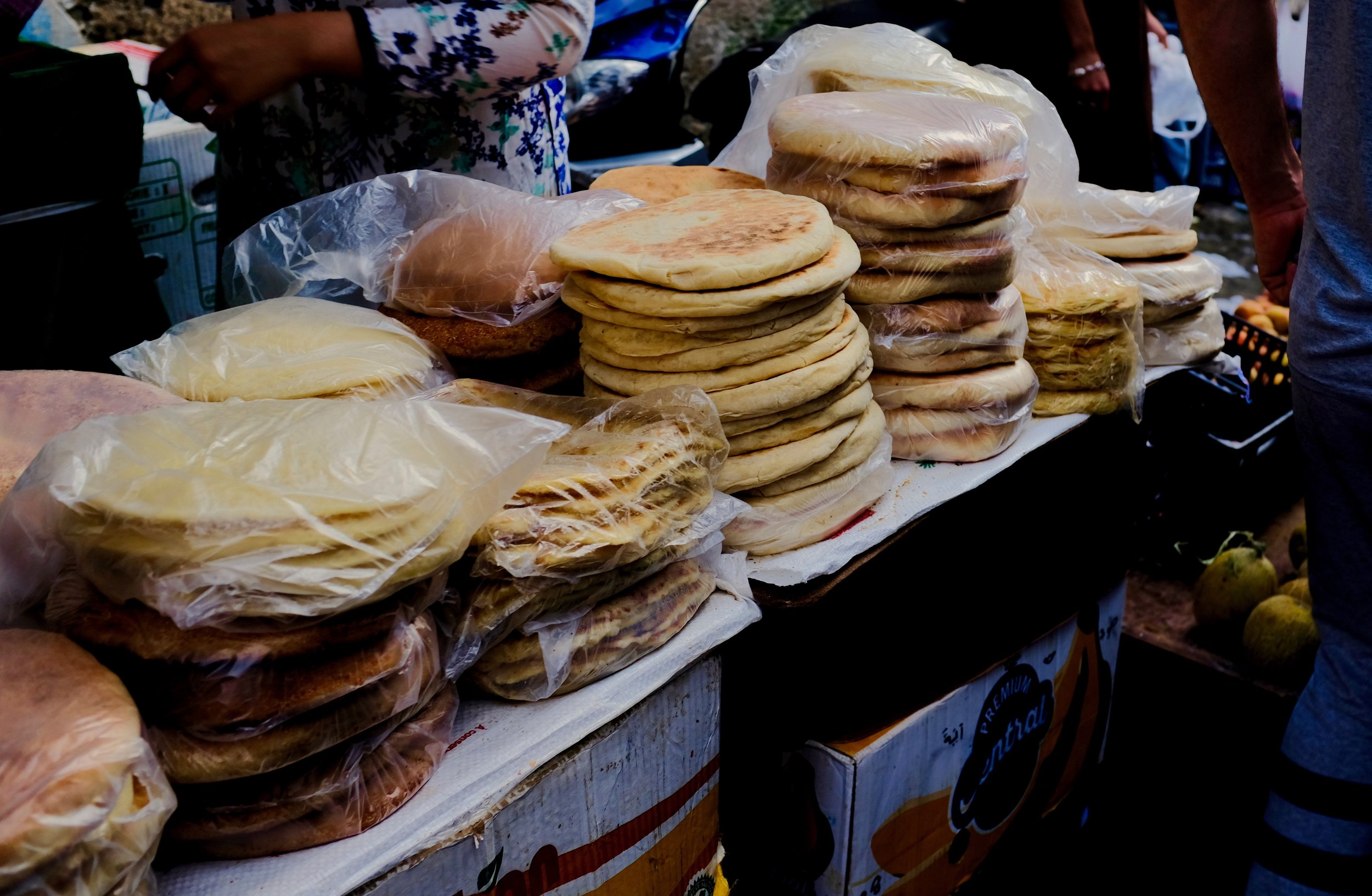 A variety of different Moroccan bread products being sold at a market in the medina of Fez, Morocco.